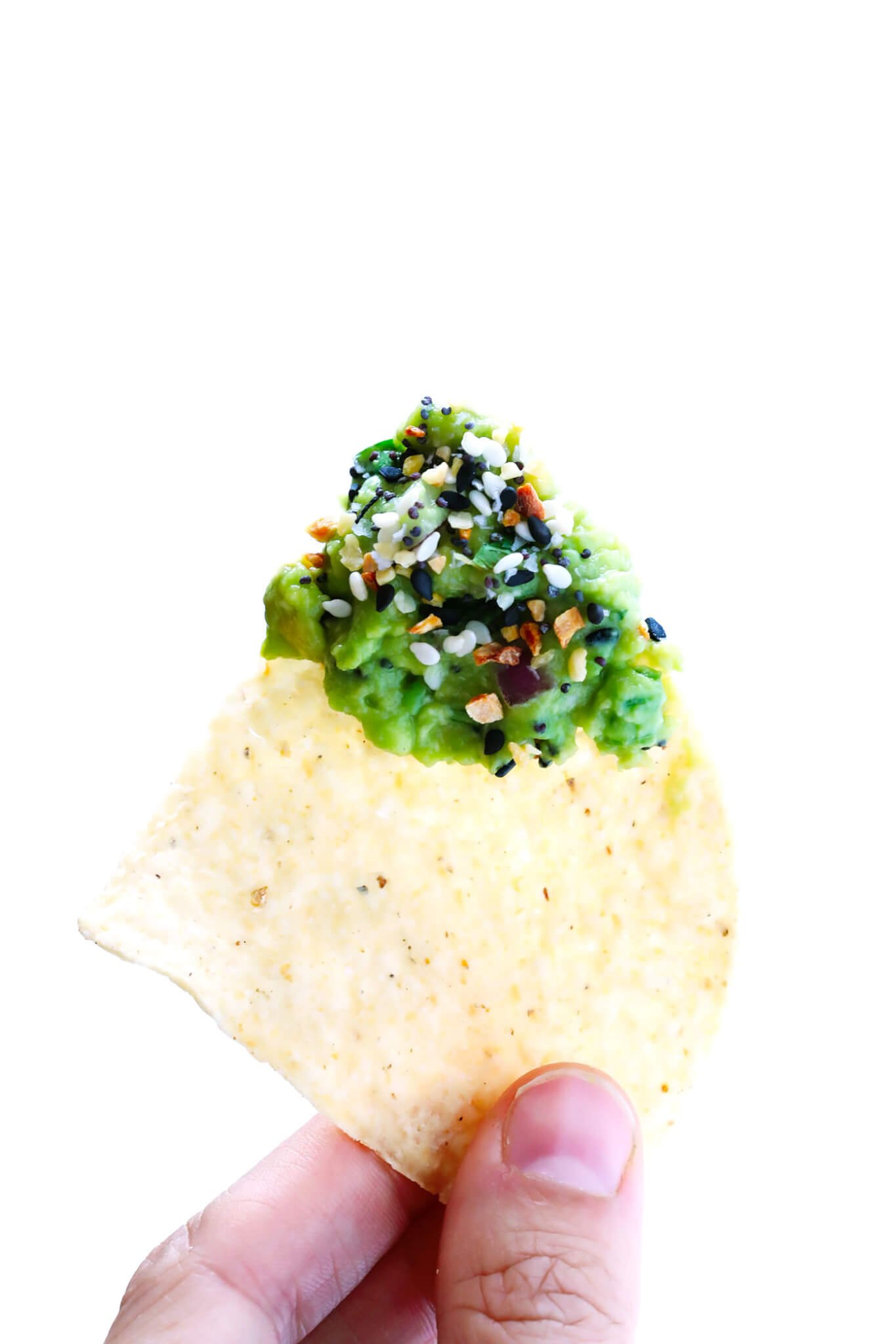"This ""Everything"" Guacamole recipe is kicked up a delicious notch with some everything bagel seasoning. It's the perfect savory appetizer dip for a party! 