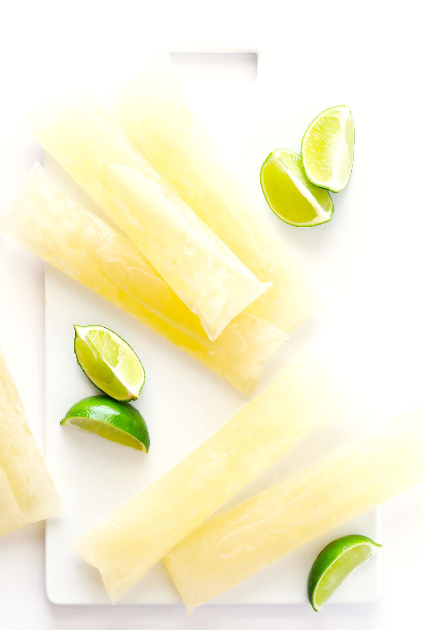 These Frozen Margarita Ice Pops are quick and easy to make, can be made with just about any kind of margarita recipe, and taste so refreshing and delicious. They're the perfect popsicles for summer! | gimmesomeoven.com