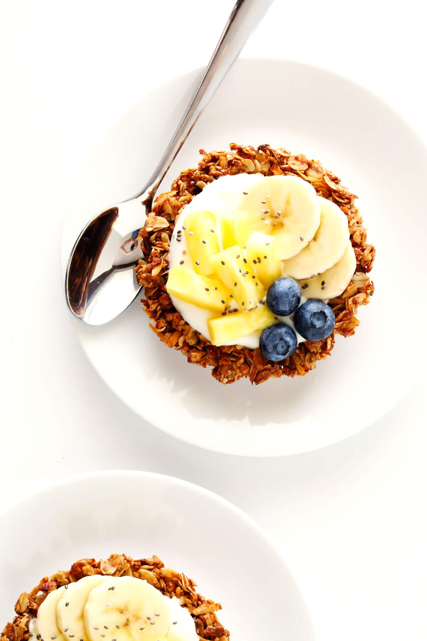 These Mini Granola Tart Cups are a cute and delicious way to serve your granola! Fill them with yogurt and fruit for breakfast, no-bake fillings for dessert, or whatever sounds good. | gimmesomeoven.com (Gluten-Free / Vegetarian)