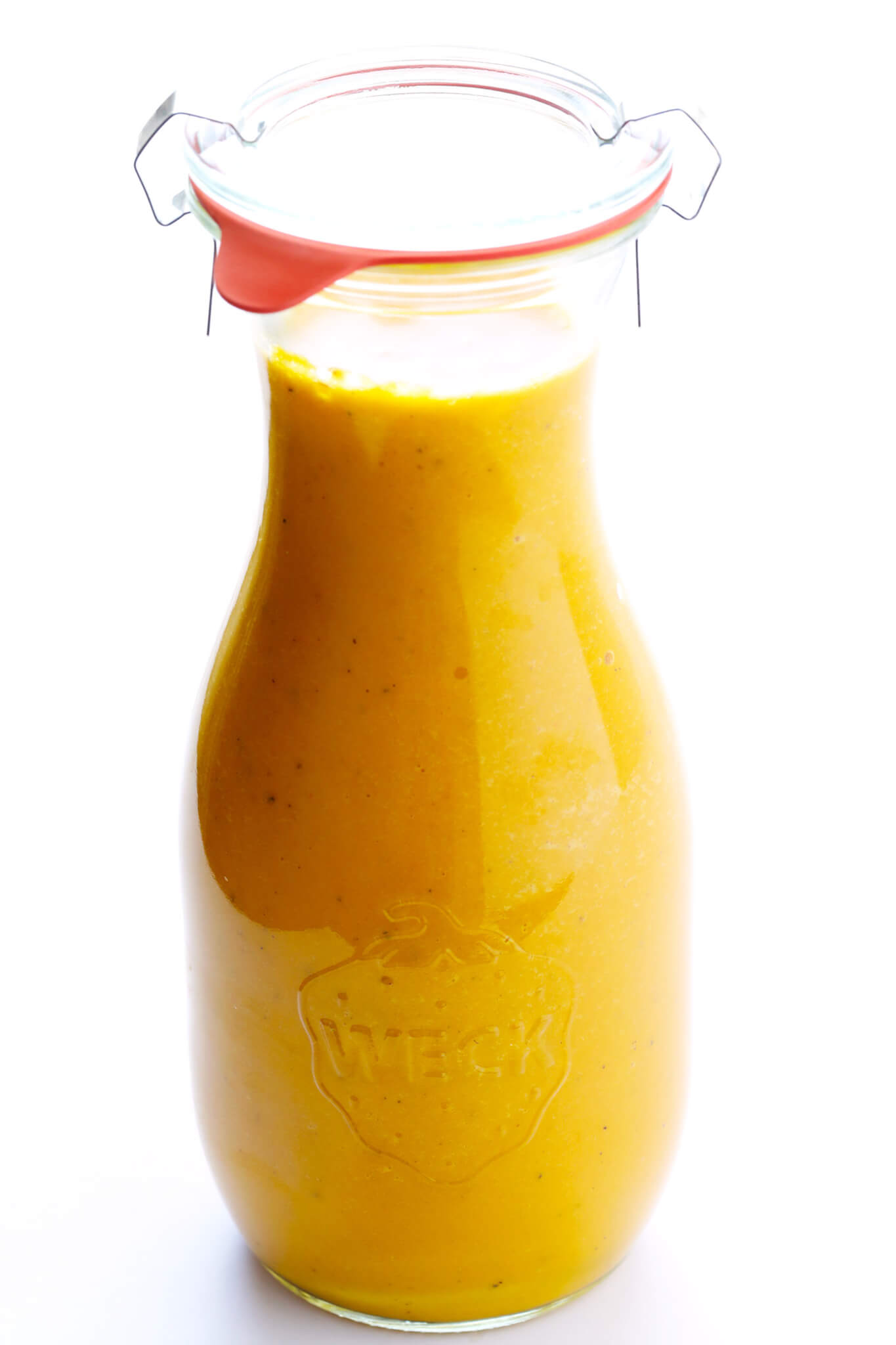 The BEST Ginger Carrot Dressing recipe! It's inspired by the Japanese restaurant version we all know and love, and made with the perfect combination of sweet and savory ingredients. It's awesome as a salad dressing, or even as a dipping sauce. | gimmesomeoven.com (Vegetarian / Gluten-Free / Vegan)