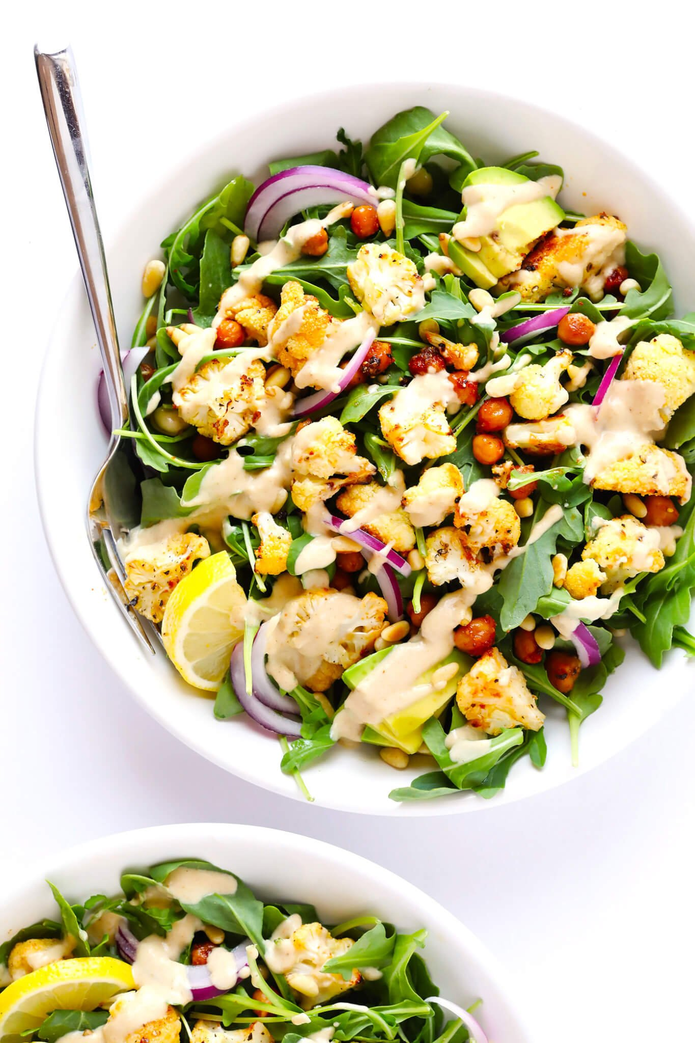 Roasted Cauliflower, Chickpea and Arugula Salad Bowls with Dreamy Tahini Dressing