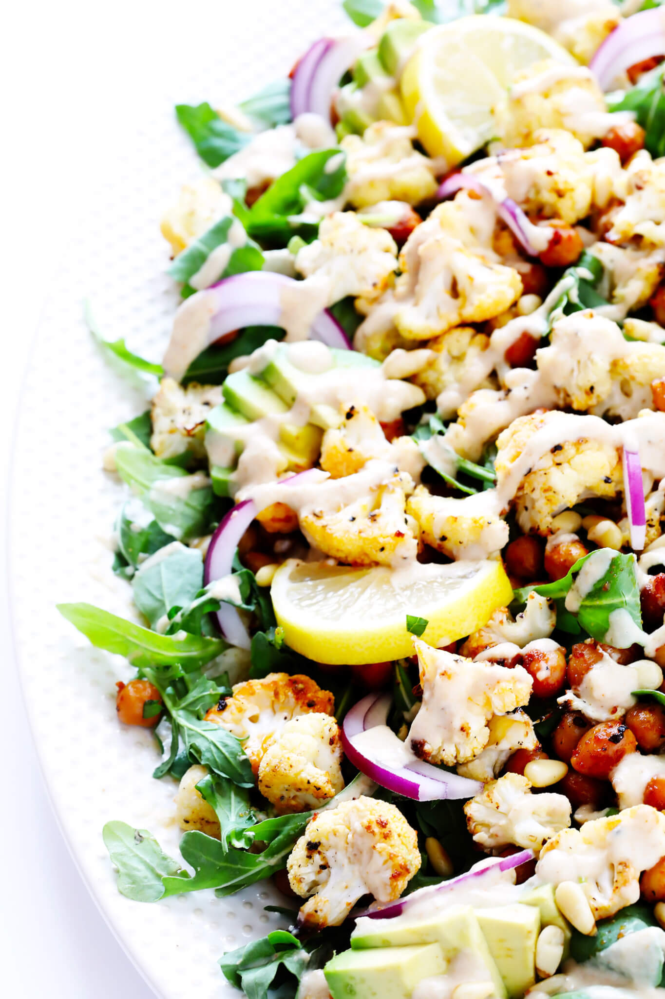 The BEST Roasted Cauliflower Salad with Chickpeas, Arugula and Tahini Dressing
