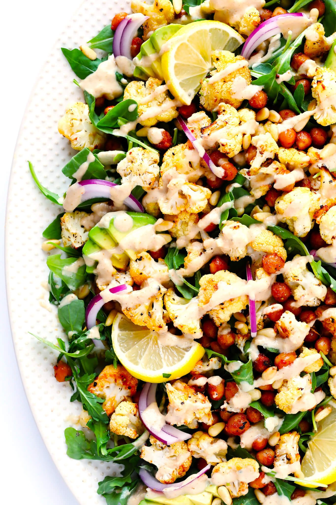 Vegetarian Roasted Cauliflower, Chickpea and Arugula Salad with Dreamy Tahini Dressing