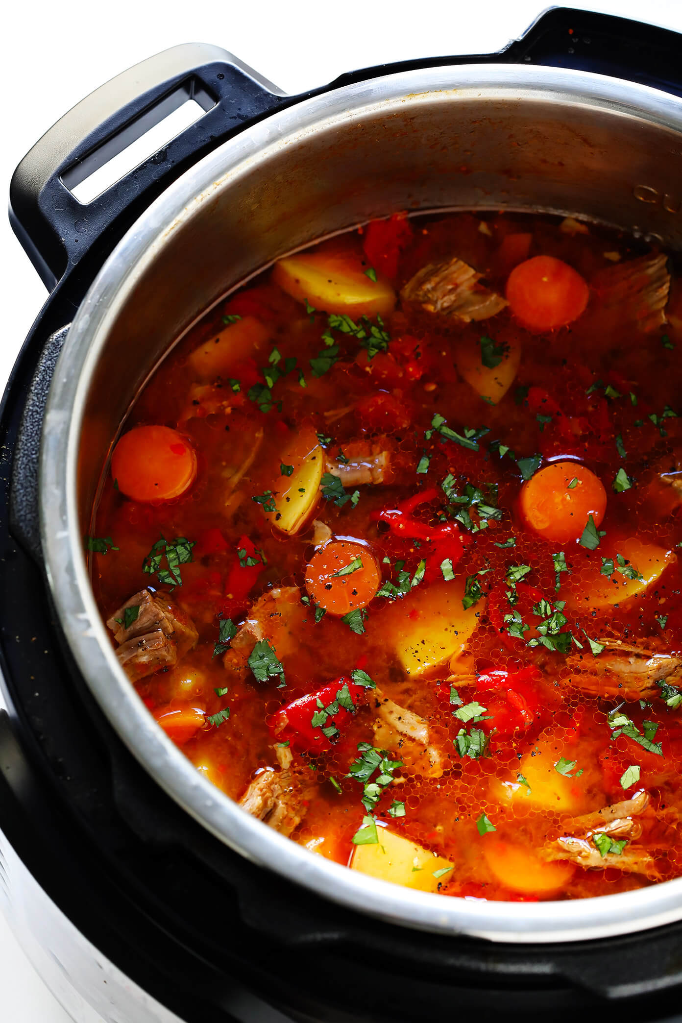 LOVE this Mexican Vegetable Beef Soup recipe! It's easy to make in the Instant Pot (pressure cooker), Crock-Pot (slow cooker), or on the stovetop. And it's full of tender steak, potatoes, carrots, roasted red peppers, tomatoes, and simmered in a delicious tomato chile broth. High recommend topping this stew with lots of fresh cilantro and avocado! #instantpot #soup #stew #pressurecooker #crockpot #slowcooker #comfortfood #beef #steak