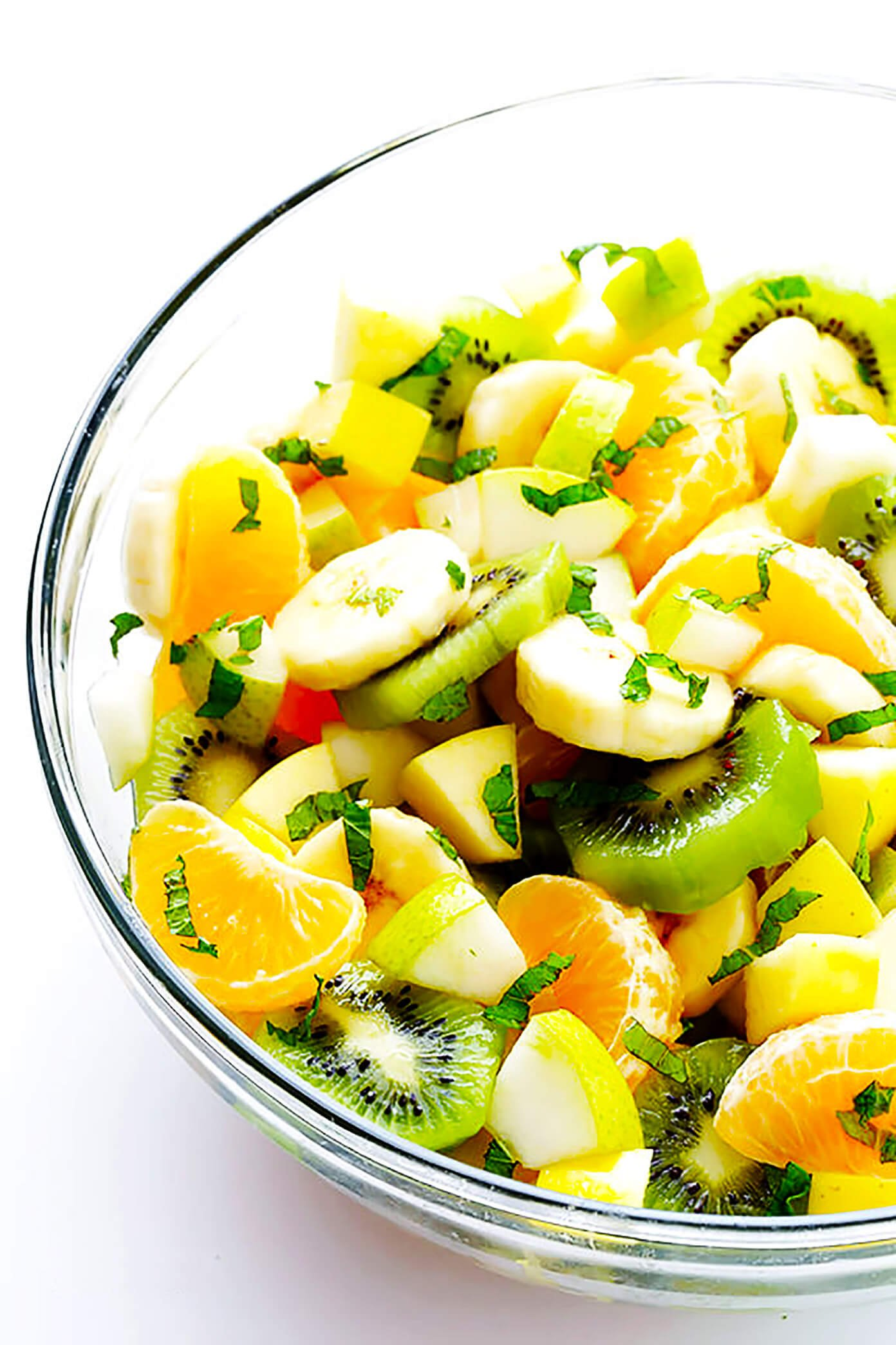 My favorite Easy Winter Fruit Salad recipe is made with apples, bananas, pears, oranges, kiwi, mint and a squeeze of honey-lime dressing. So simple and delicious! (Also gluten-free!)