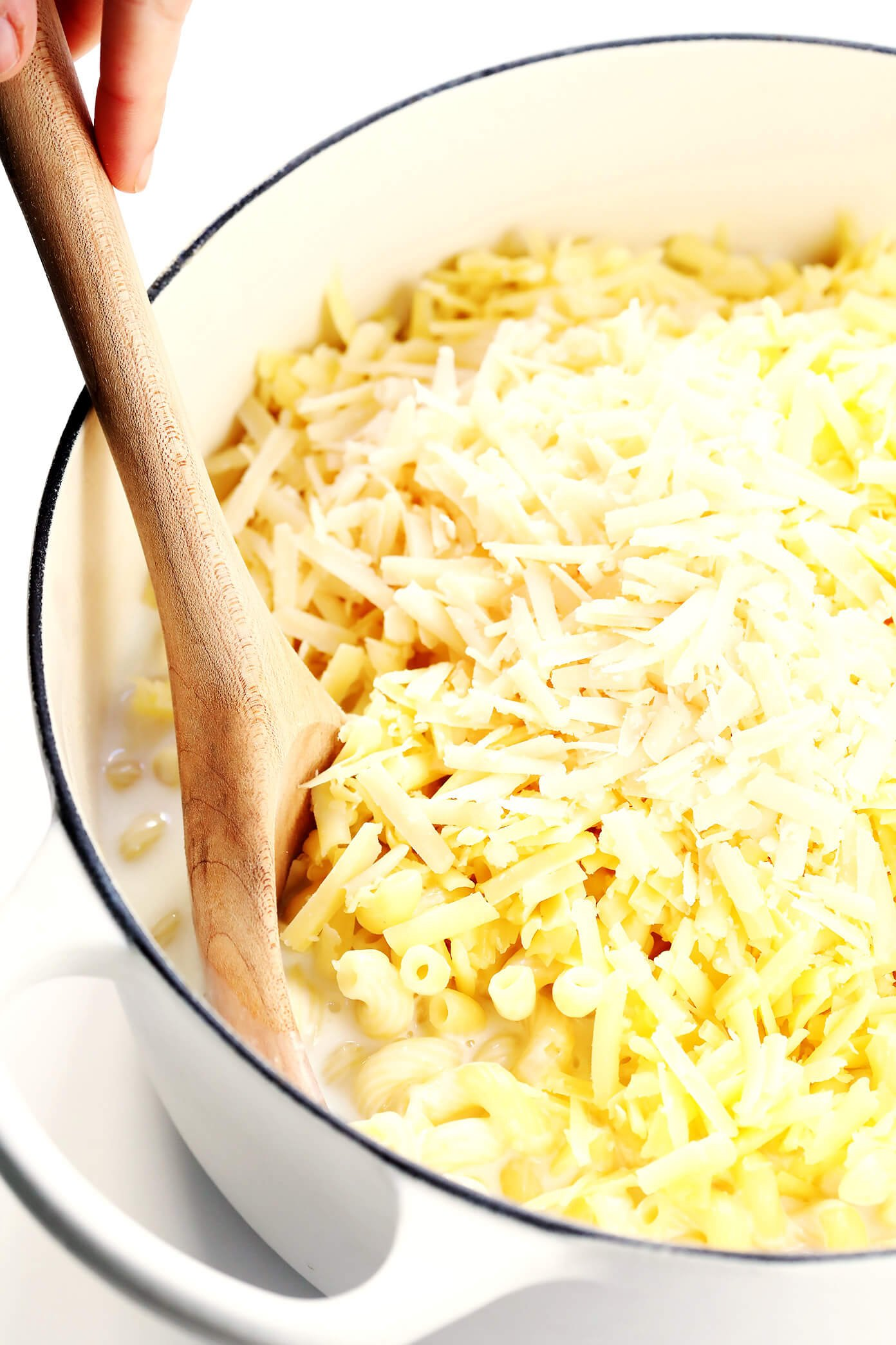 Seriously the BEST Stovetop Mac and Cheese recipe! It's ready to go in about 20 minutes, only requires one pot, and is totally creamy and cheesy and delicious. | Gimme Some Oven #macandcheese #pasta #recipe #comfortfood