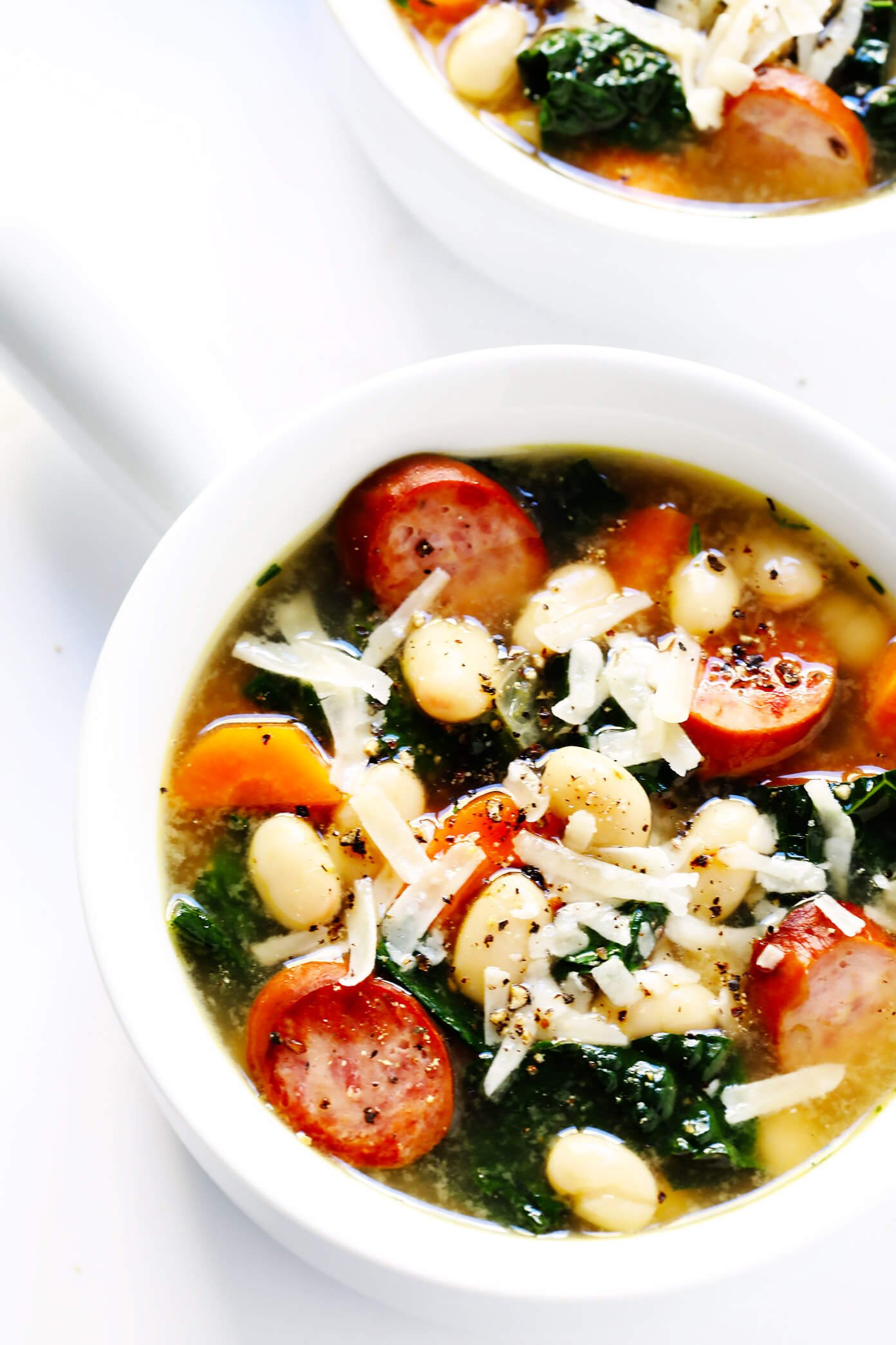 This Tuscan White Beans, Sausage and Kale Soup is one of my favorite winter dinner recipes. It's easy to make, full of cozy Italian flavors, and it's so warm and comforting. | Gimme Some Oven #souprecipe #healthysoup #italianrecipes