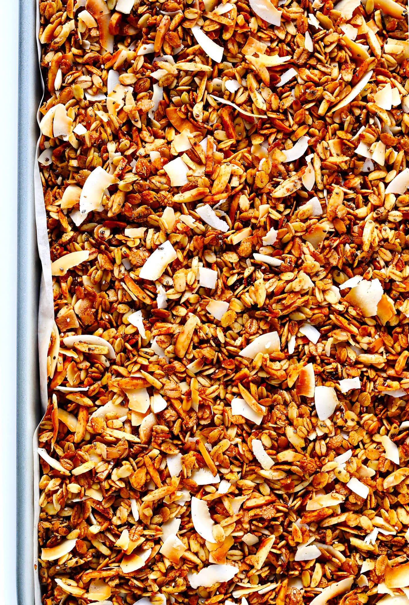 LOVE this healthy granola recipe! It's easy to make, naturally sweetened with (minimal!) maple syrup, it's naturally gluten-free, and SO delicious. Perfect for a healthy breakfast or snack! | Gimme Some Oven #healthy #recipe #cleaneating #glutenfree #vegan