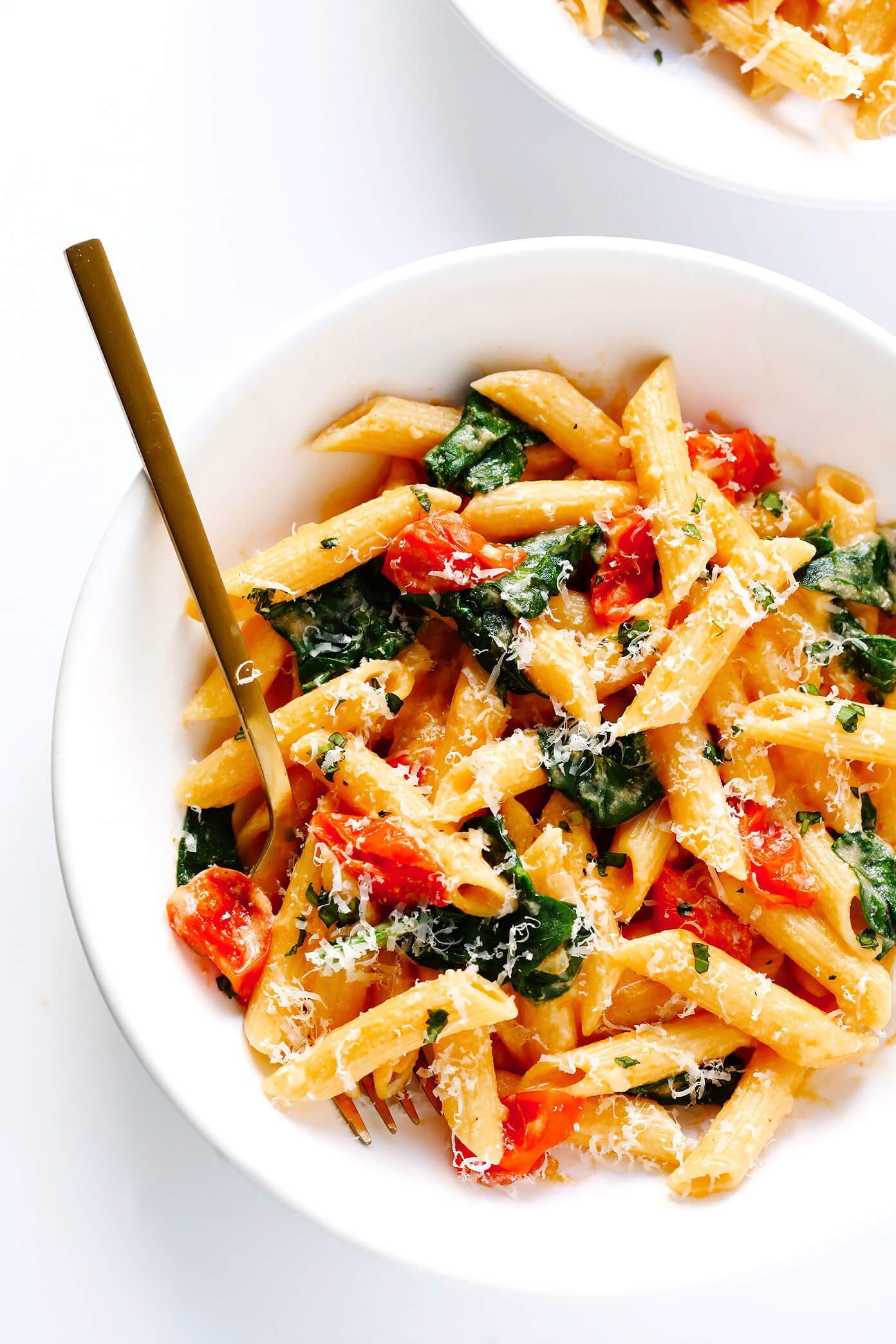Creamy Rosé Wine Pasta with Roasted Tomatoes and Spinach in bowl