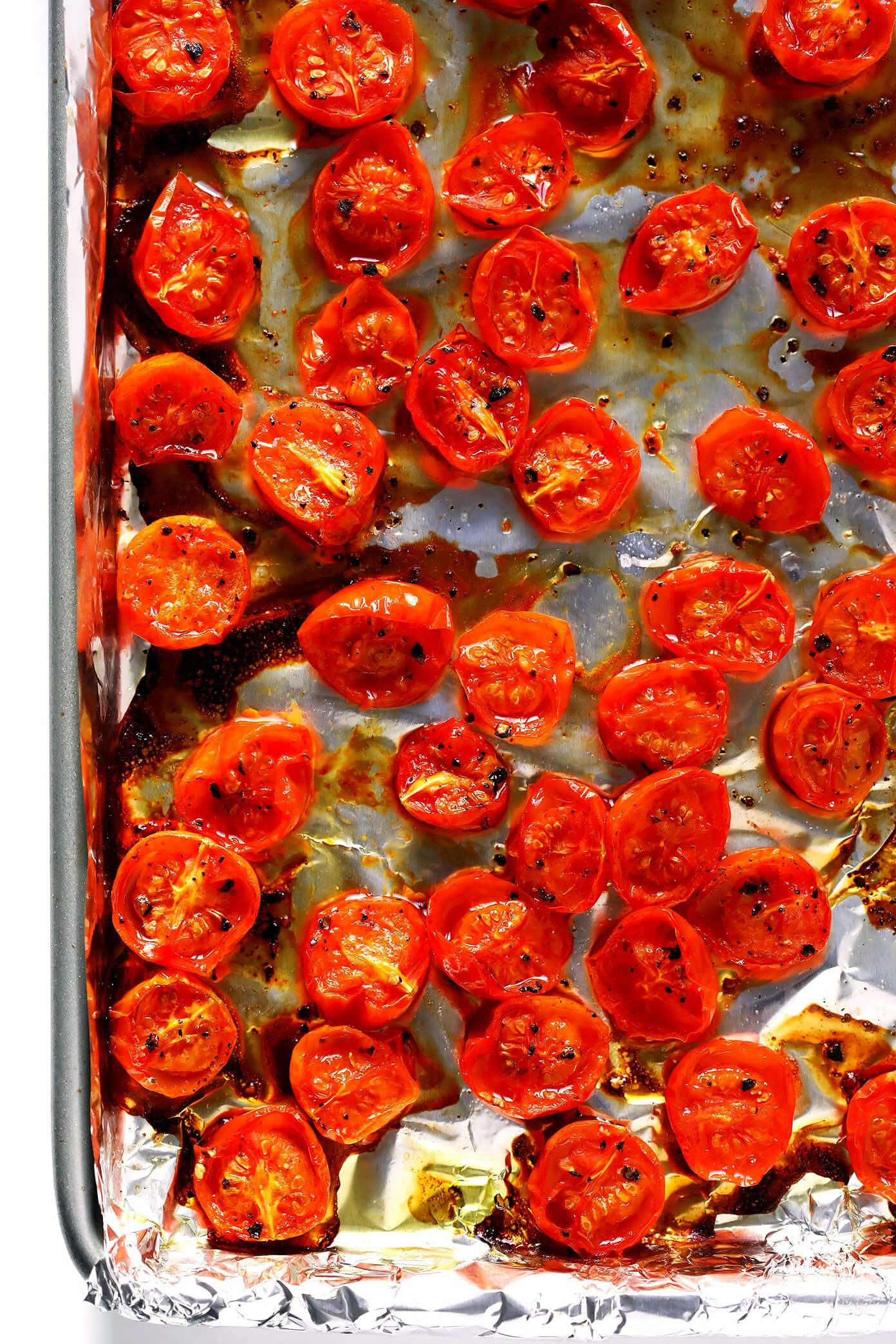 Juicy roasted tomatoes on a sheet pan