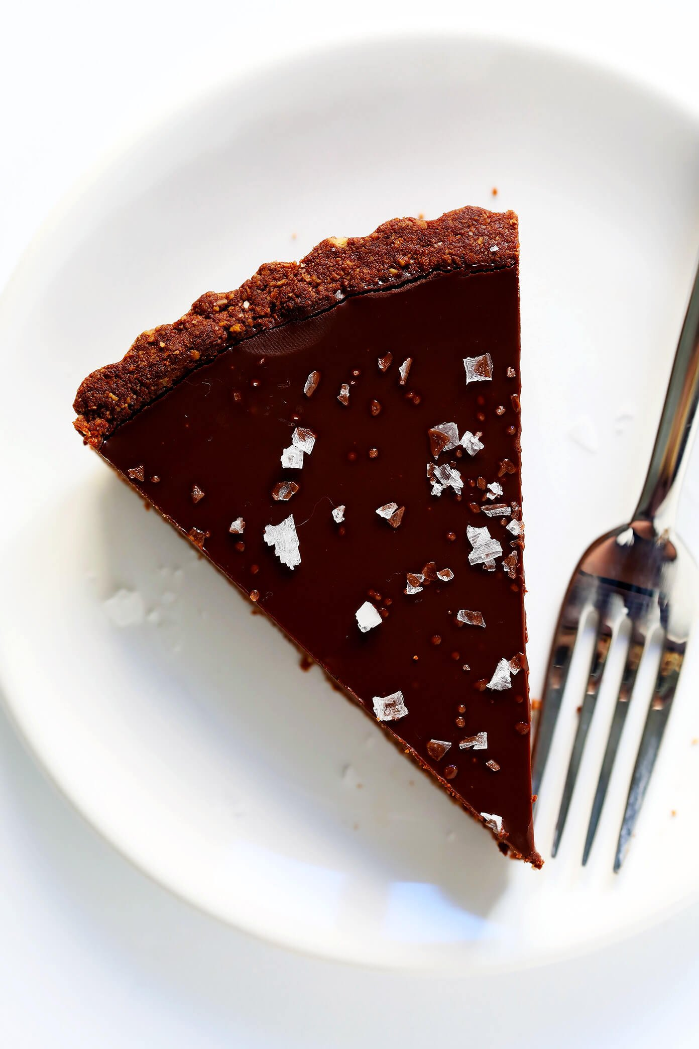 Piece of Salted Dark Chocolate Tart on plate