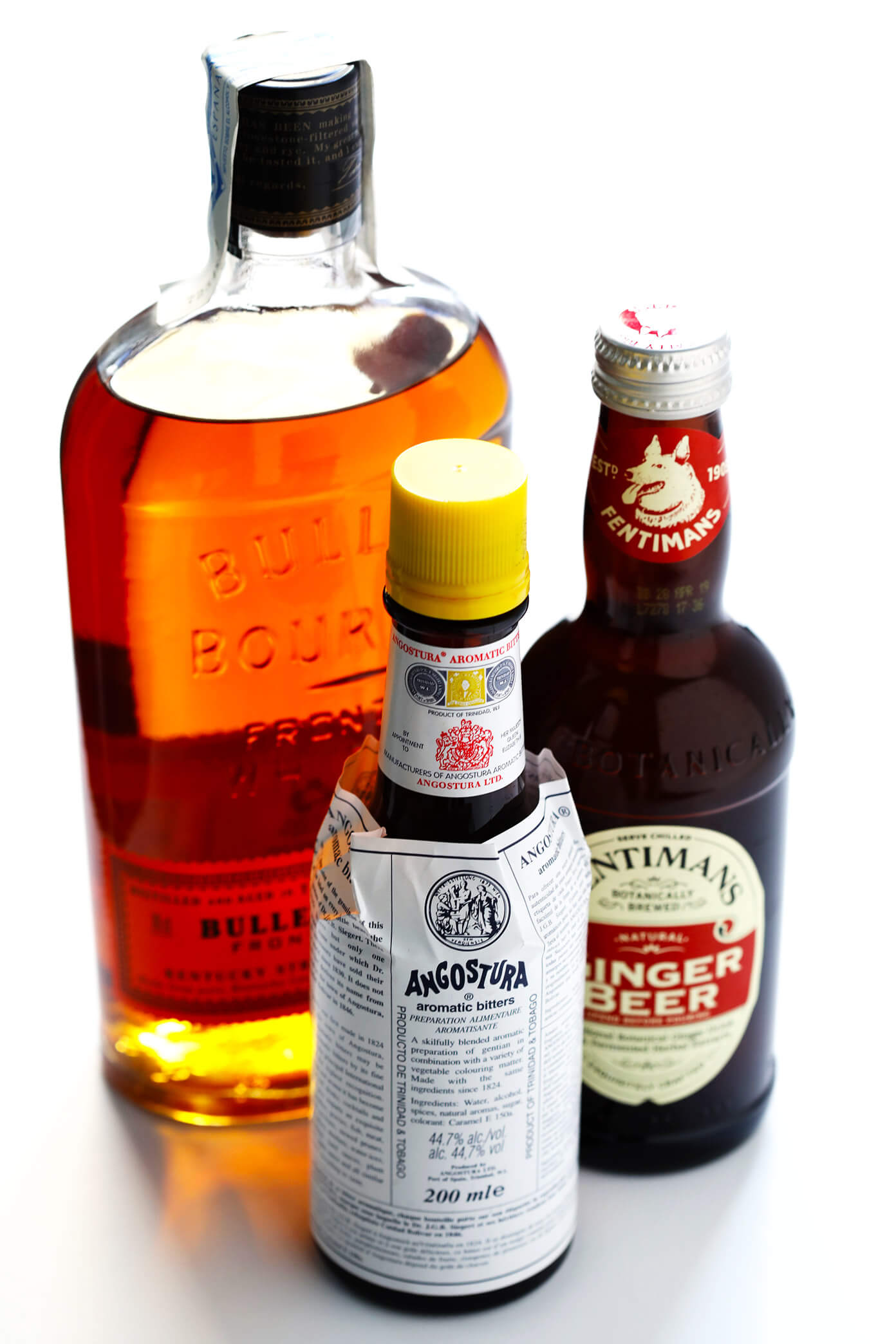 Ingredients for a Horsefeather Cocktail: bourbon, bitters, ginger beer
