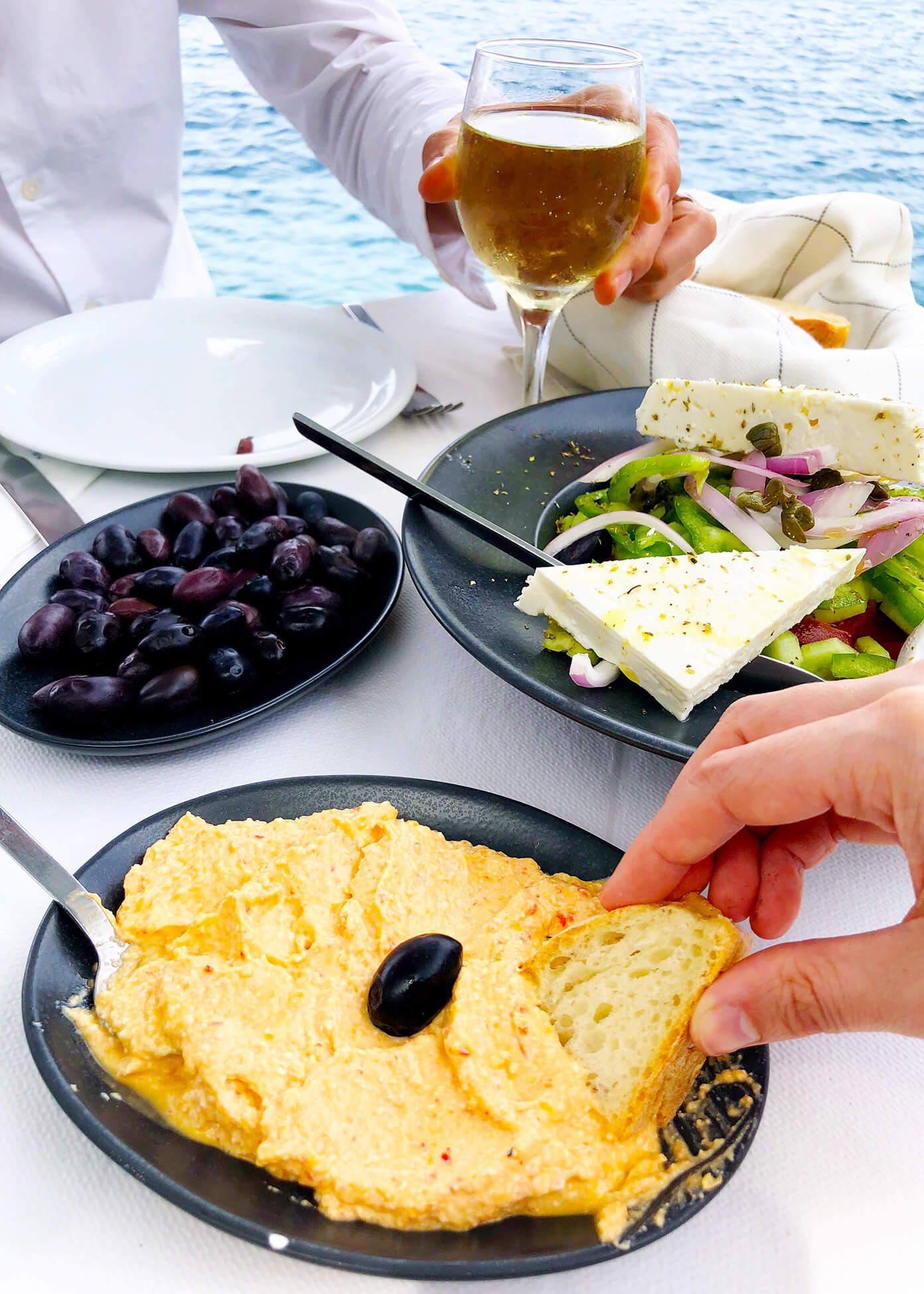 Spicy Cheese Dip, Olives and Greek Salad for Lunch at Sunset Taverna in Santorini, Greece