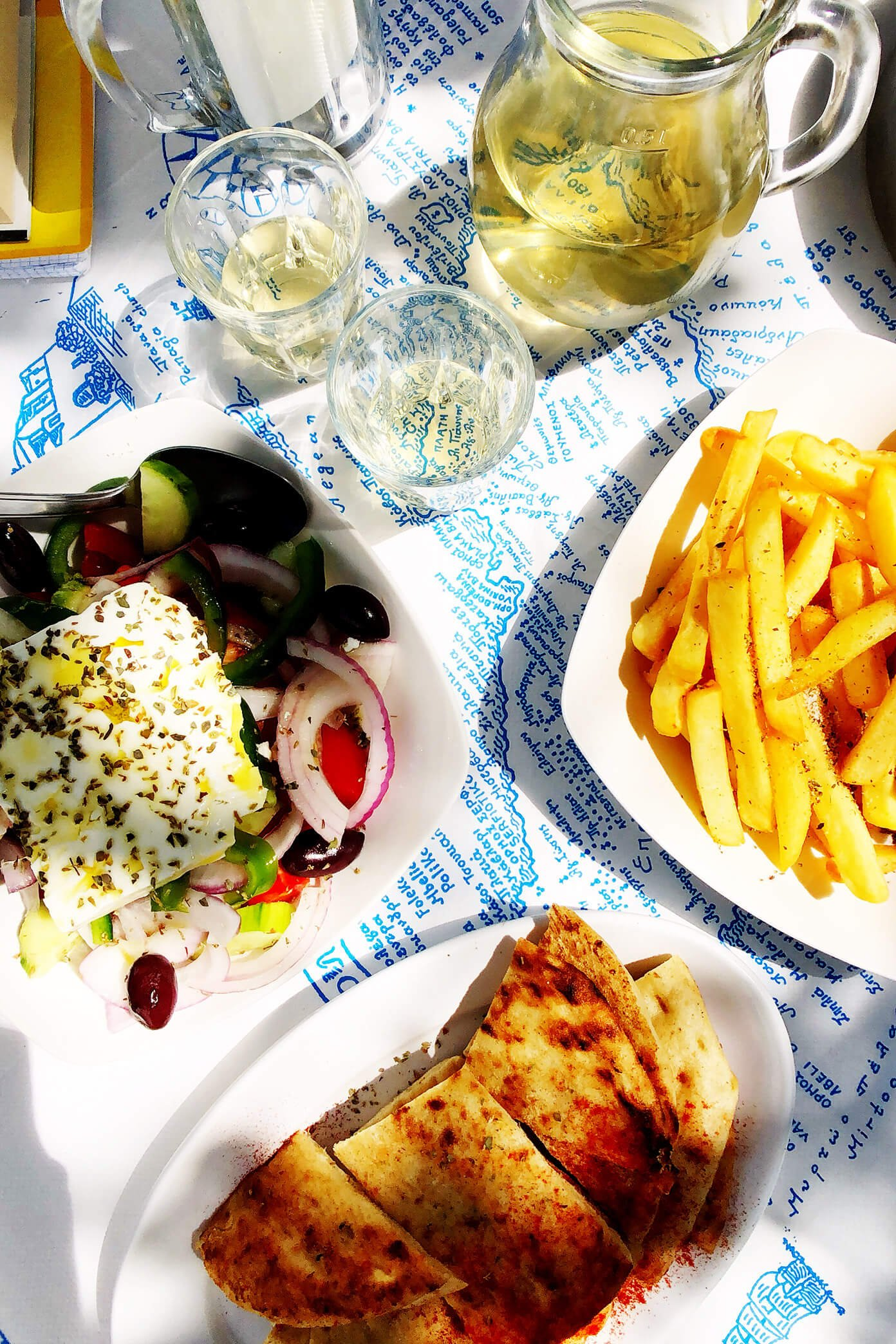 Greek Salad, Pita, Fries and Wine at Souvlaki Club Restaurant in Folegandros, Greece