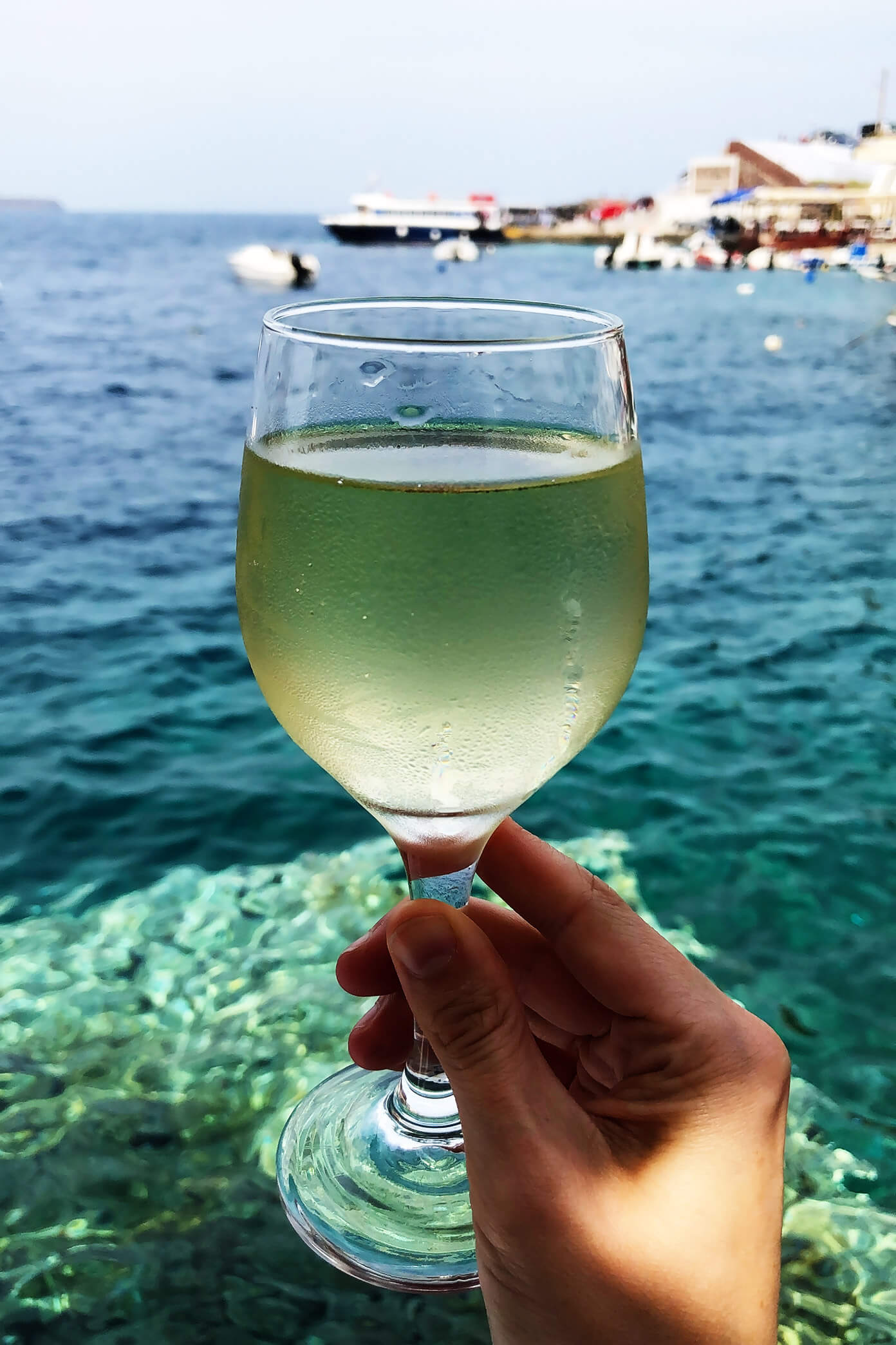 White Wine at Sunset Tavern in Santorini, Greece