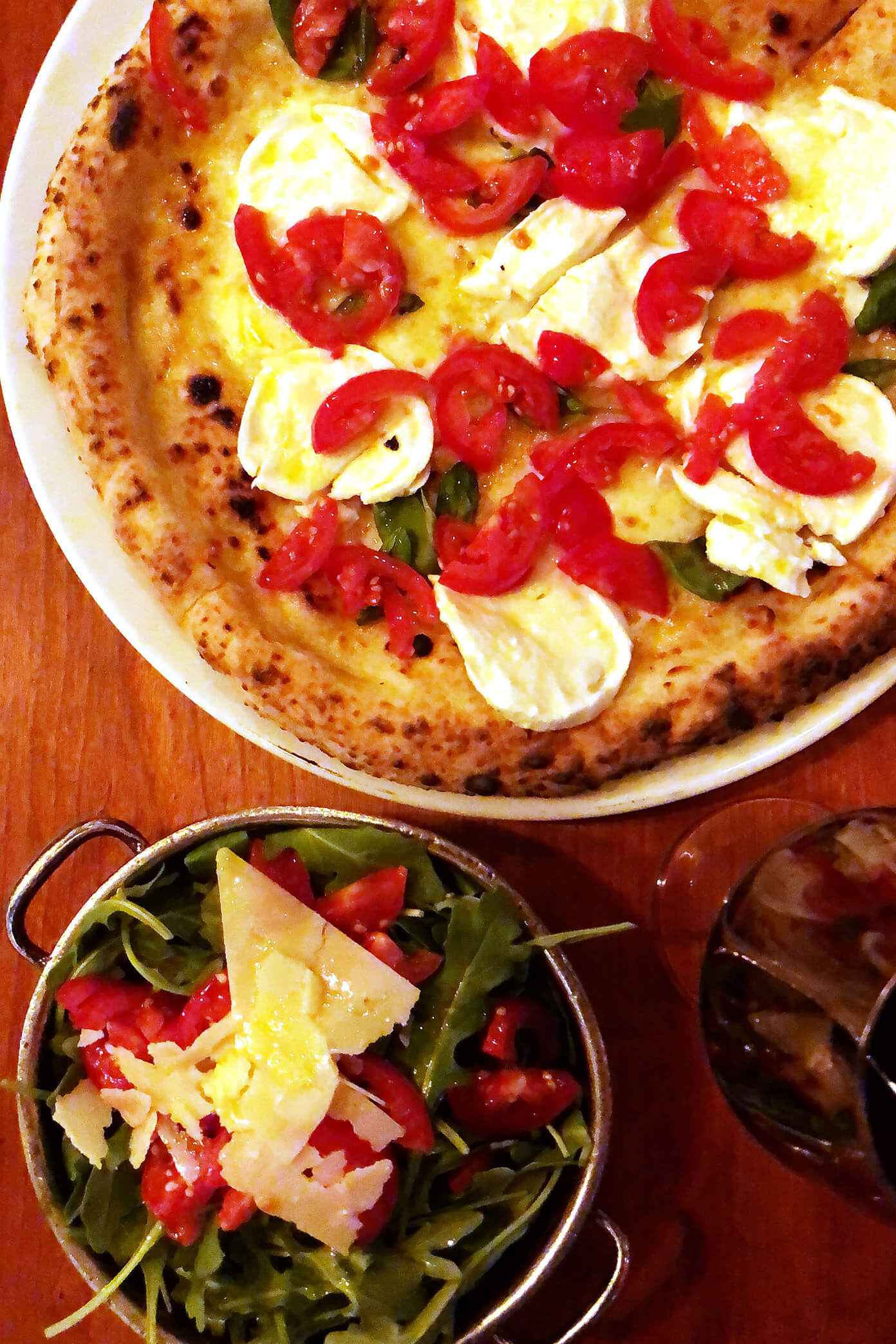 Buffalo Cheese Mozzarella Pizza and Arugula Salad at Giro in Stockhom, Sweden