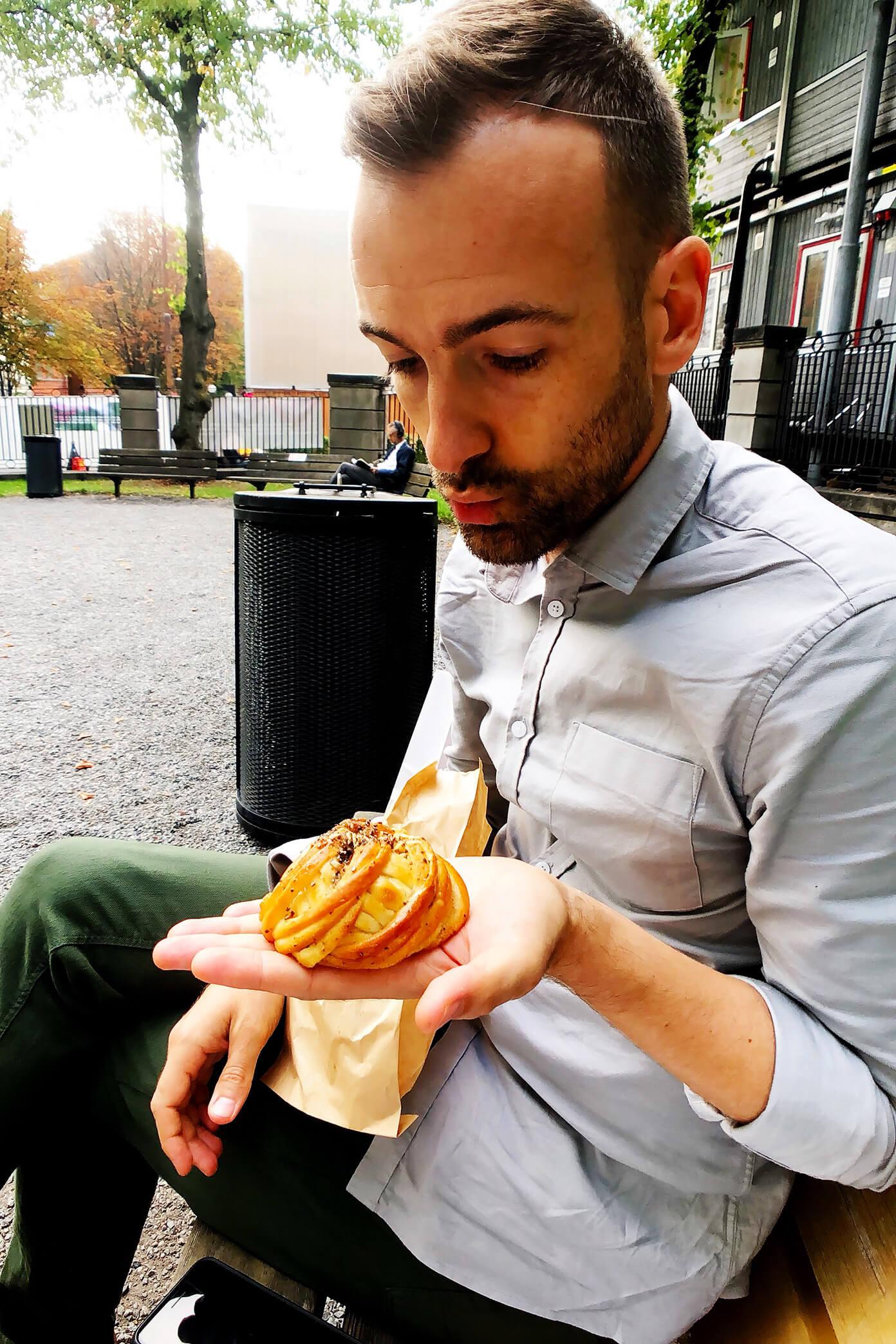 Cardamom bun in the park in Stockholm, Sweden
