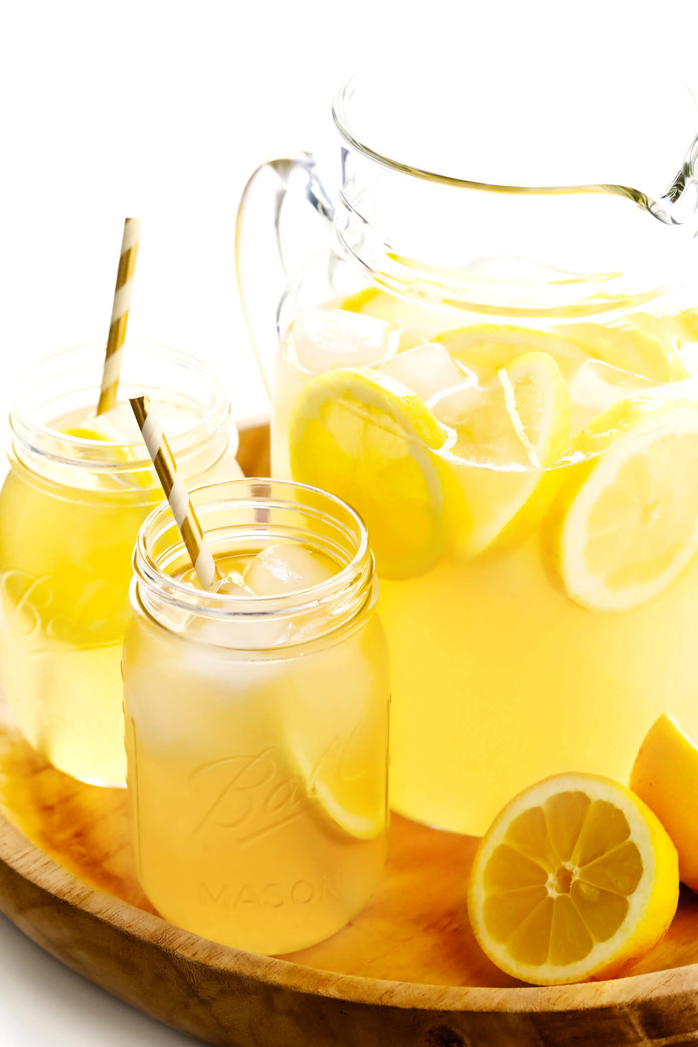 The BEST 3-ingredient homemade lemonade recipe -- naturally sweetened with maple syrup or honey, and easy to make in just 5 minutes! | gimmesomeoven.com #lemonade #drink #summer #juice