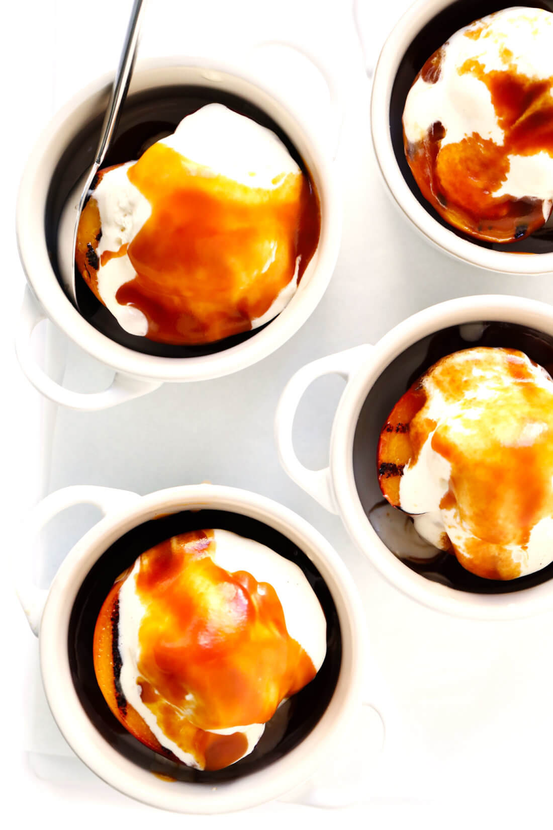Easy summer dessert recipe -- grilled peaches with ice cream and bourbon caramel sauce
