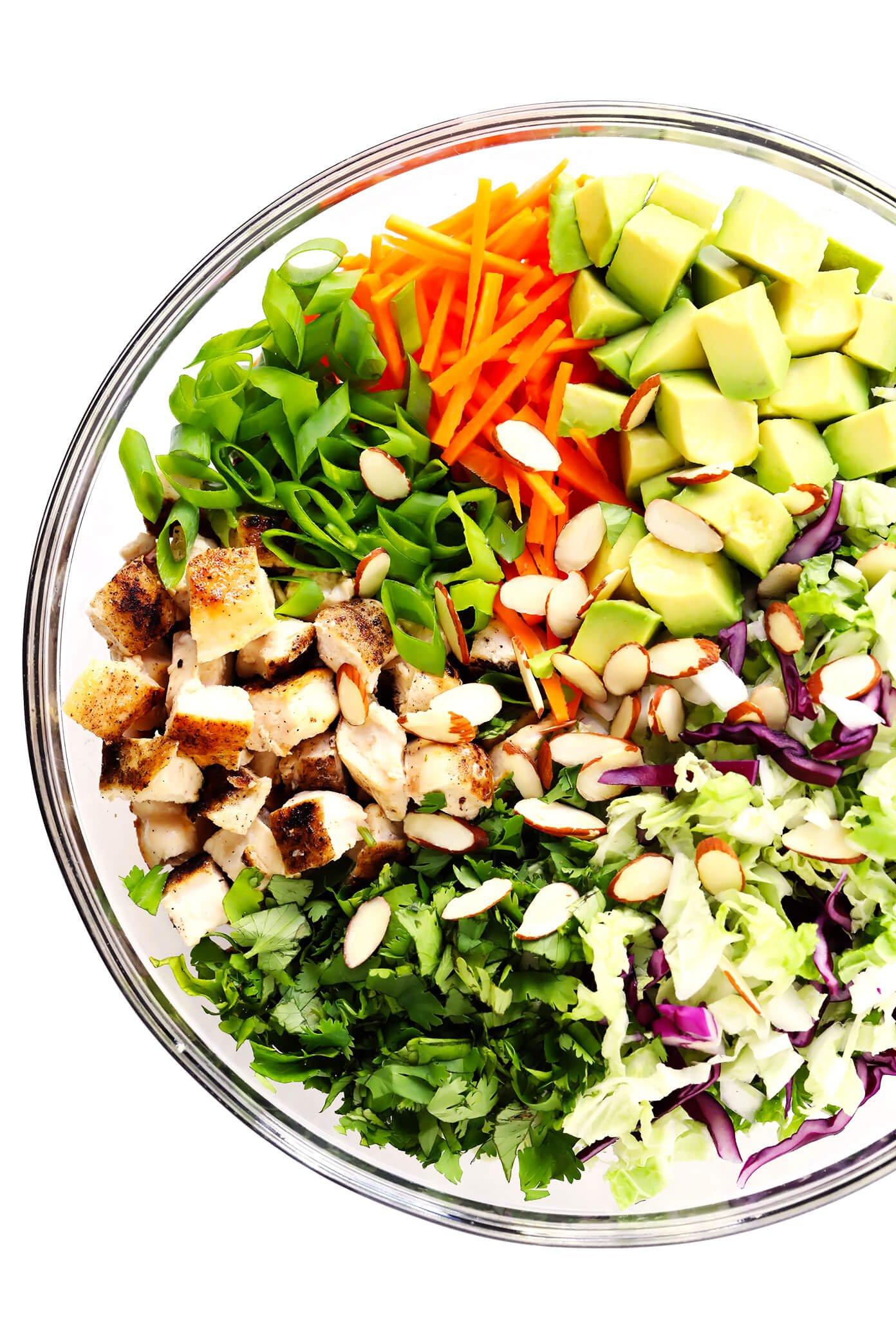 Sesame Chicken Salad Ingredients (Baked Chicken, Green Onions, Carrots, Cilantro, Cole Slaw, Avocado and Toasted Almonds)