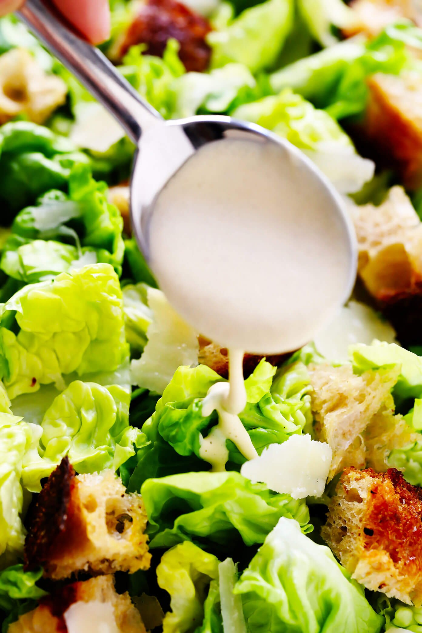 Caesar Dressing Drizzled On Caesar Salad