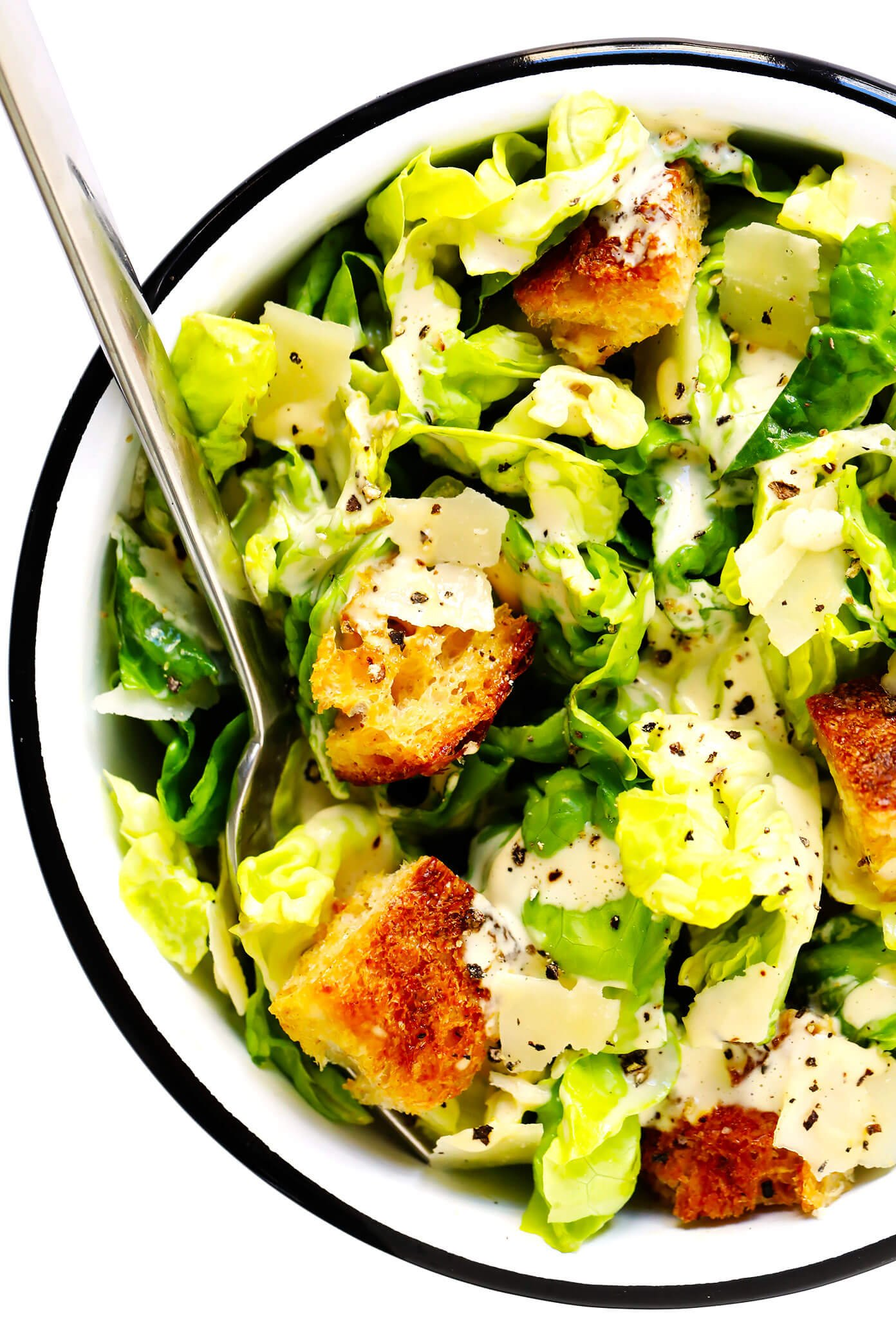 Caesar Salad In Bowl With Croutons and Parmesan