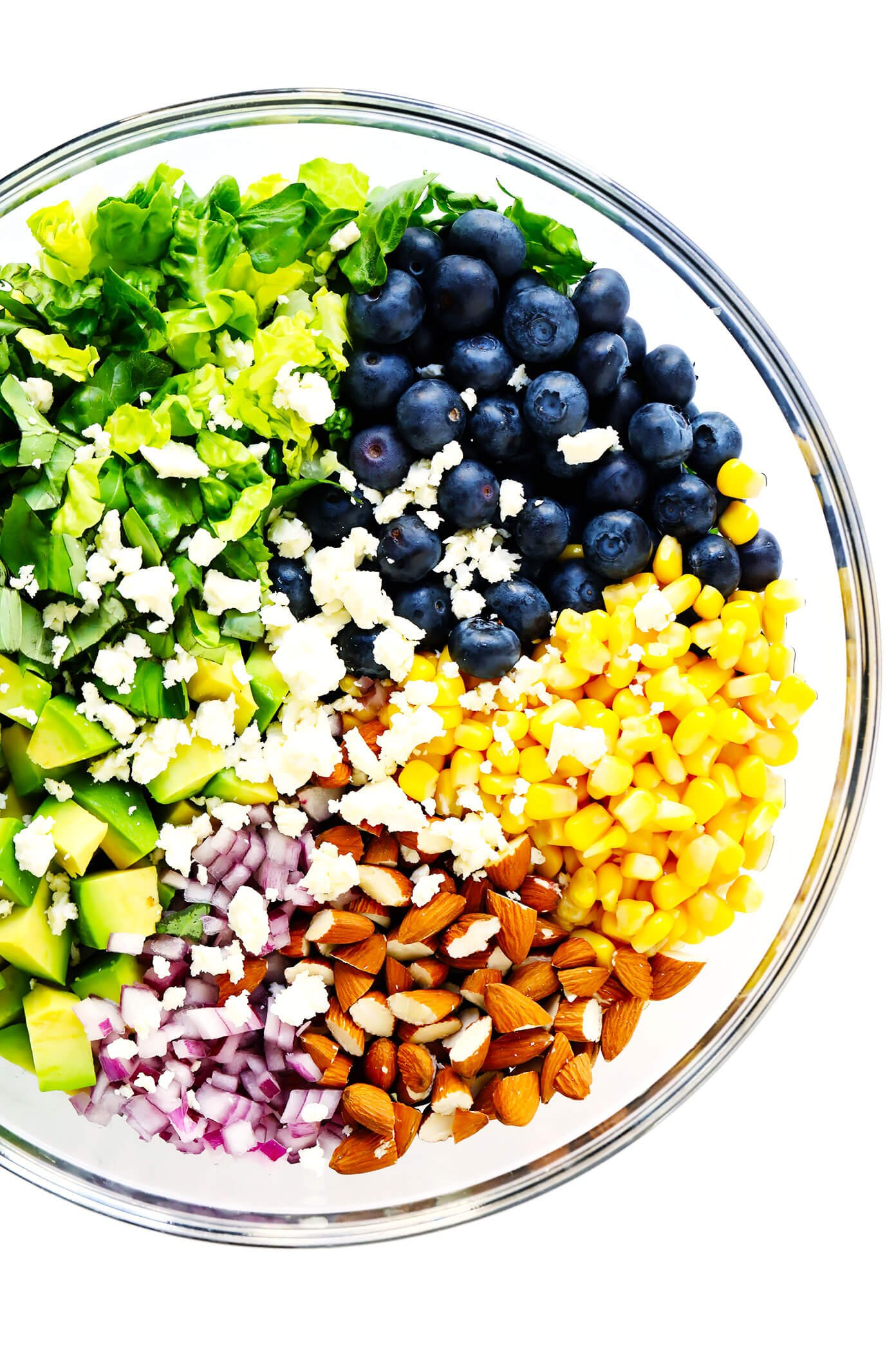 Bowl of ingredients to make blueberry corn and avocado chopped salad