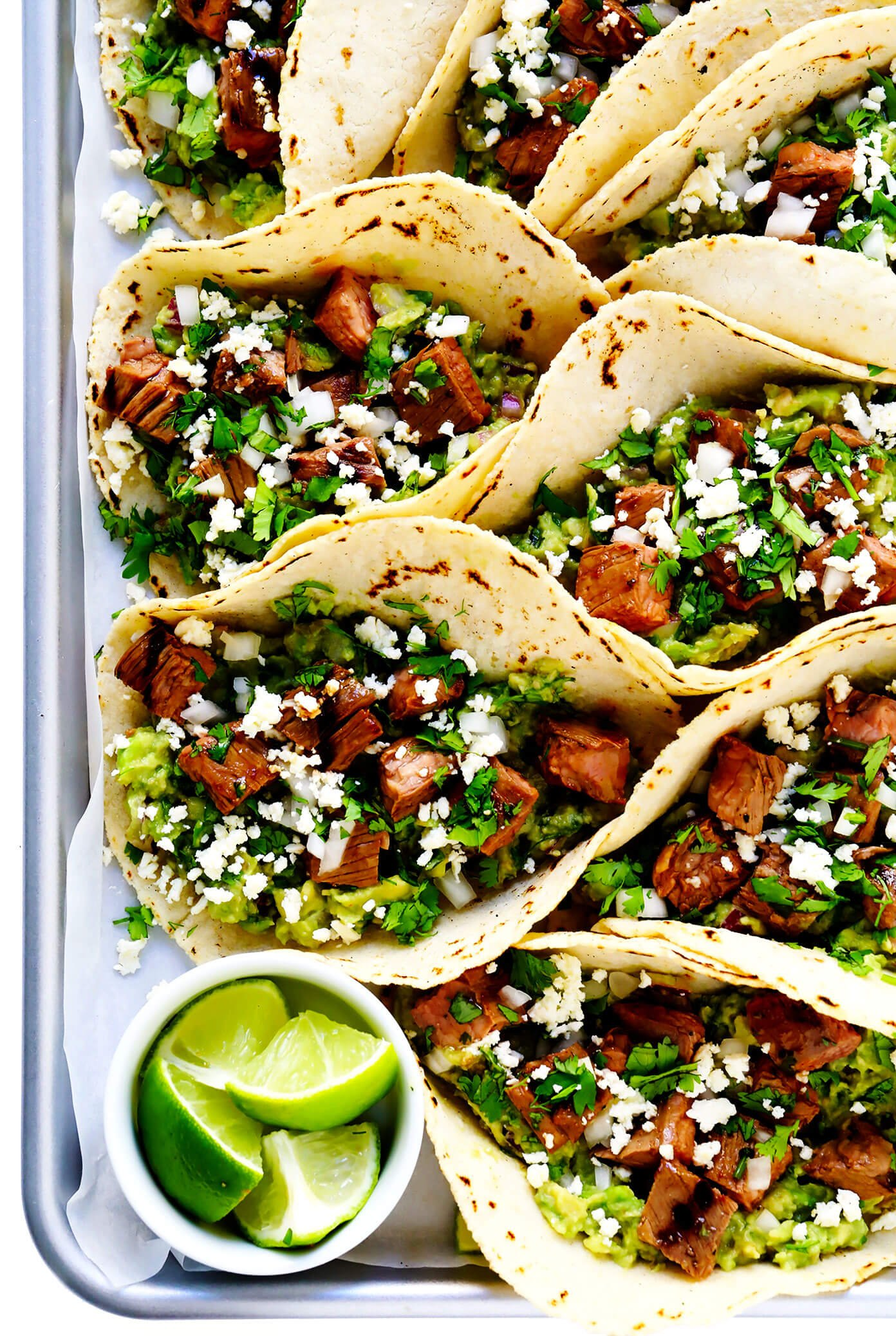 Tray of Carne Asada Tacos with Lime, Guacamole and Queso Fresco