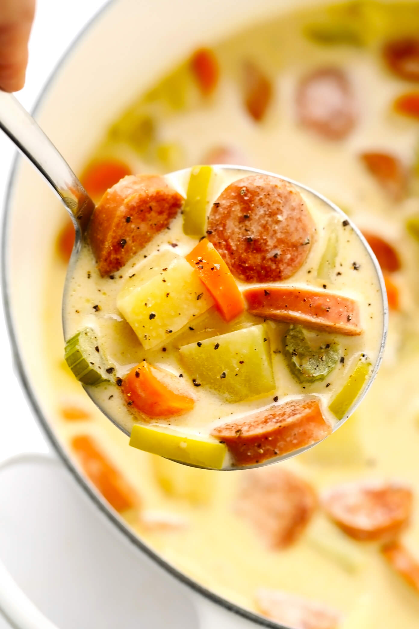 Smoked Sausage, Apple and Potato Soup Closeup in Ladle