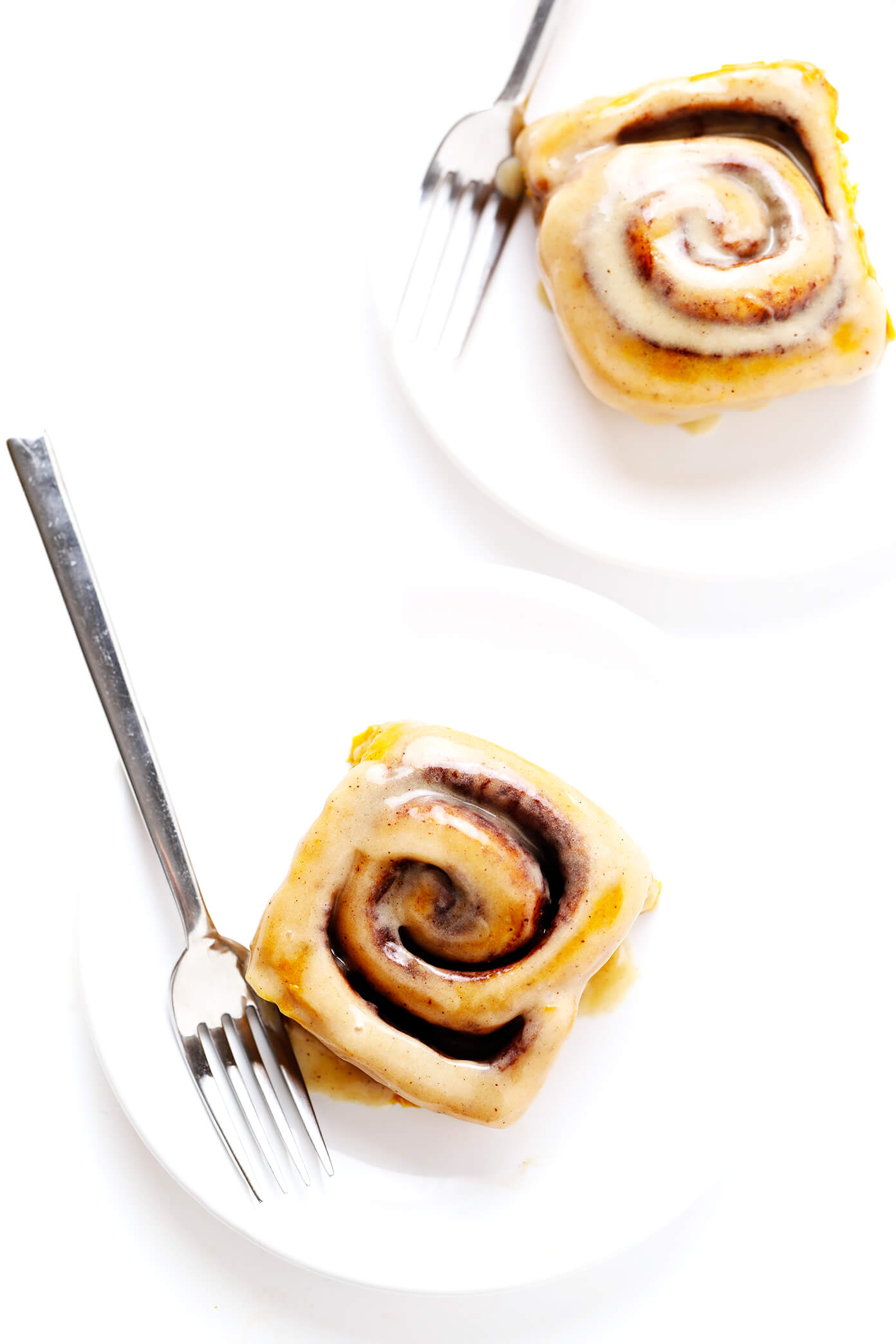 Individual Pumpkin Cinnamon Rolls on Plates with Forks