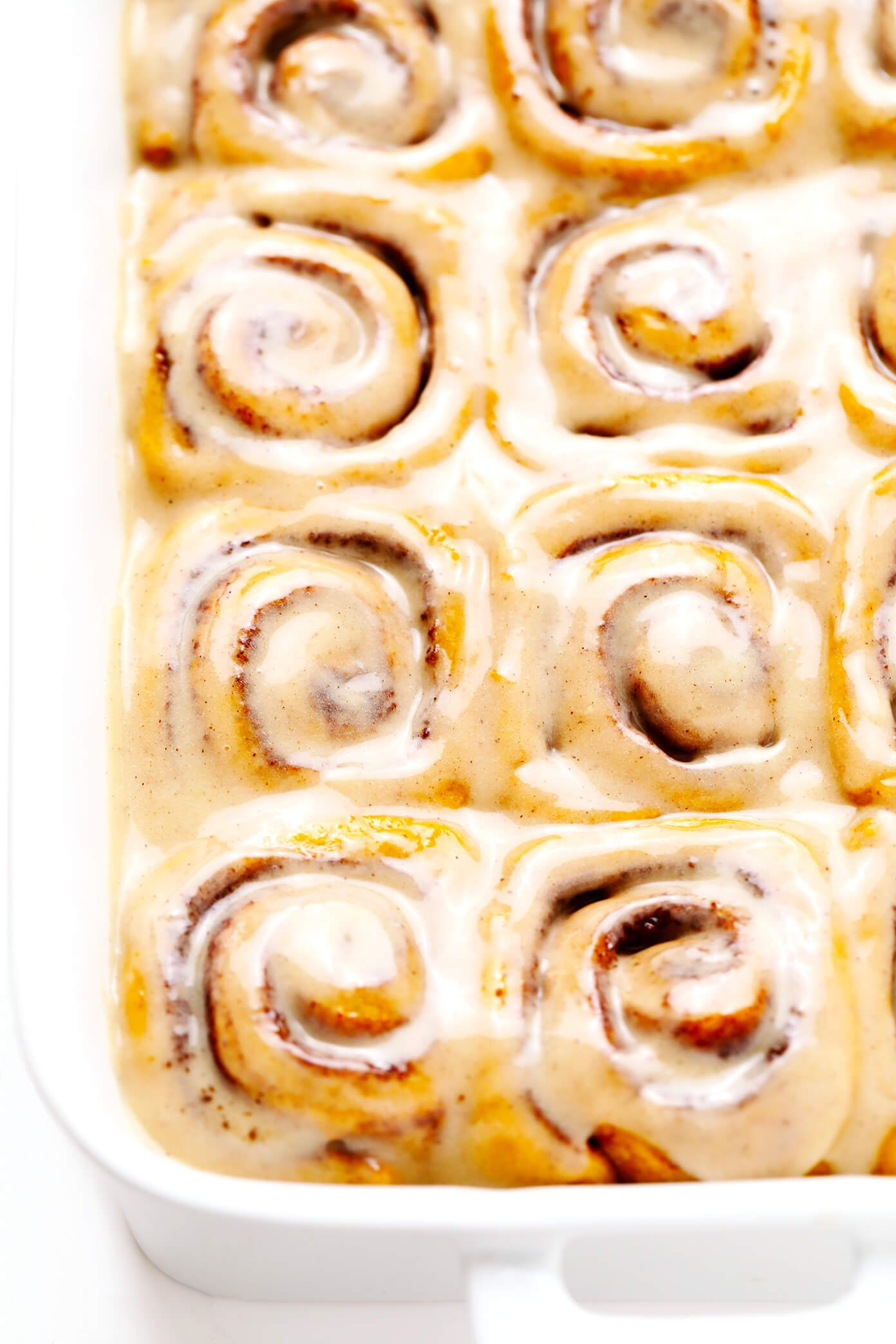 Pumpkin Cinnamon Rolls with Maple Frosting In Pan