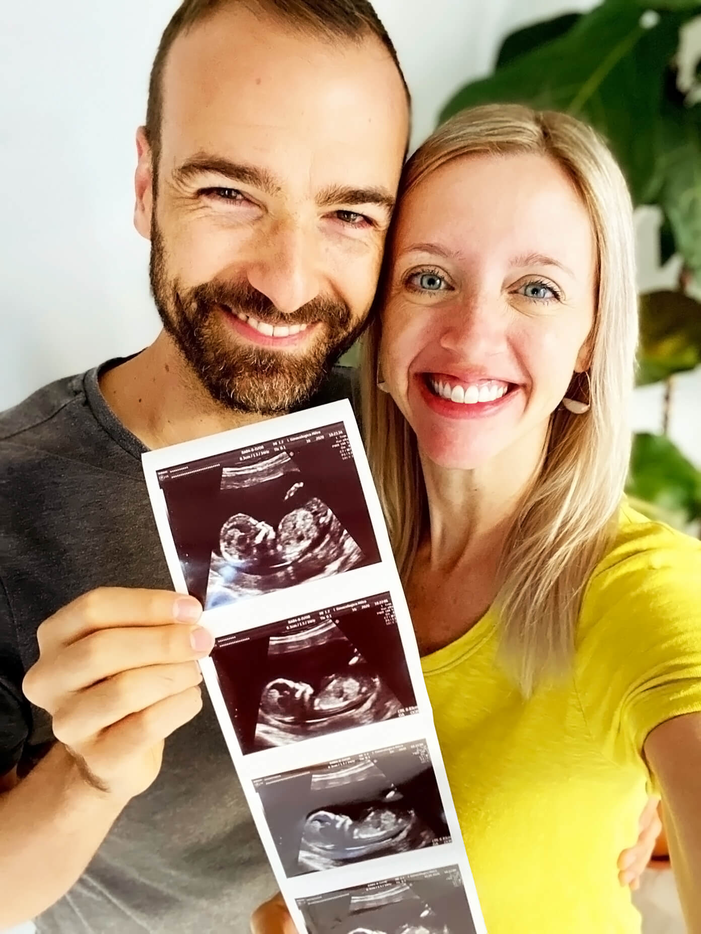 Ali and Barclay Holding Sonogram Photos