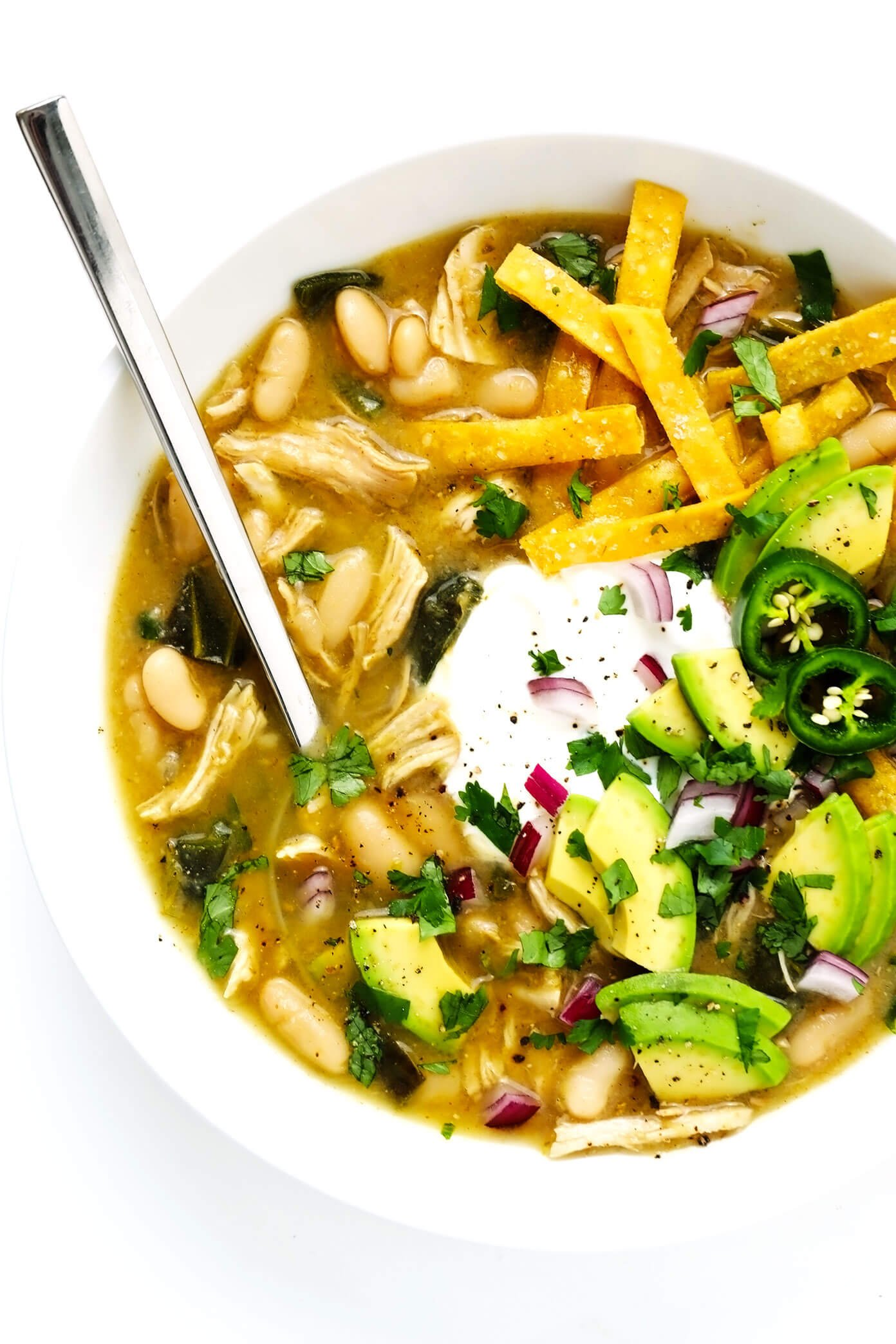 Poblano White Chicken Chili in Bowl with Avocado and Cilantro Toppings