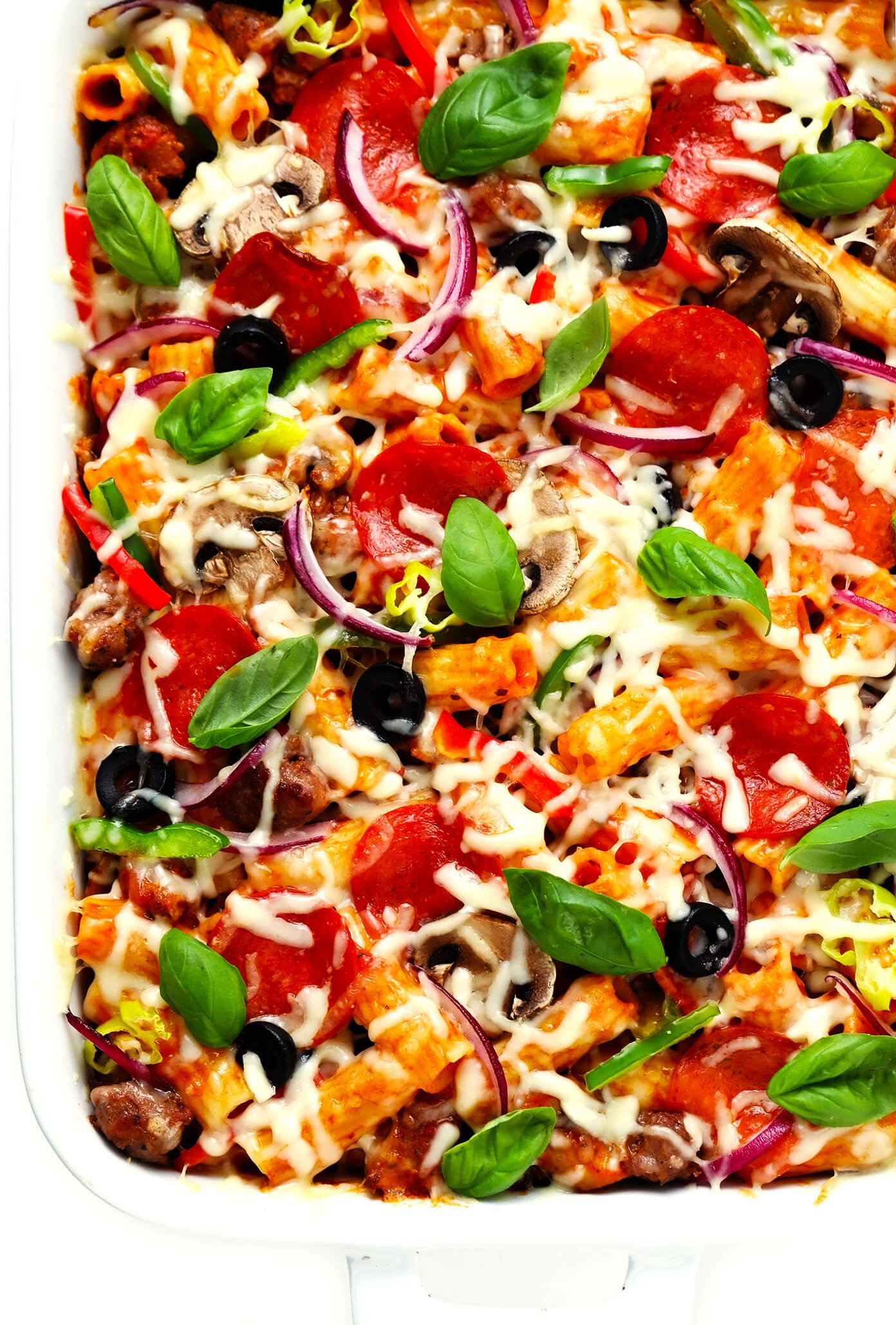 Pizza Baked Ziti in Baking Dish with Basil Garnish