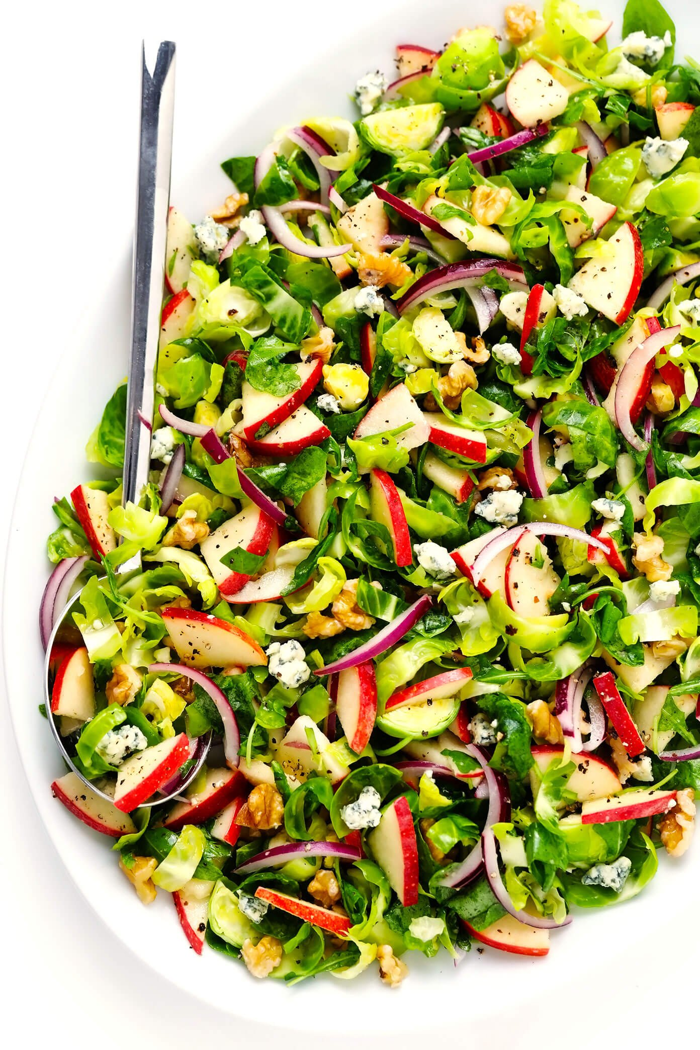 Brussels Sprouts Salad with Apples, Walnuts and Blue Cheese in Serving Bowl