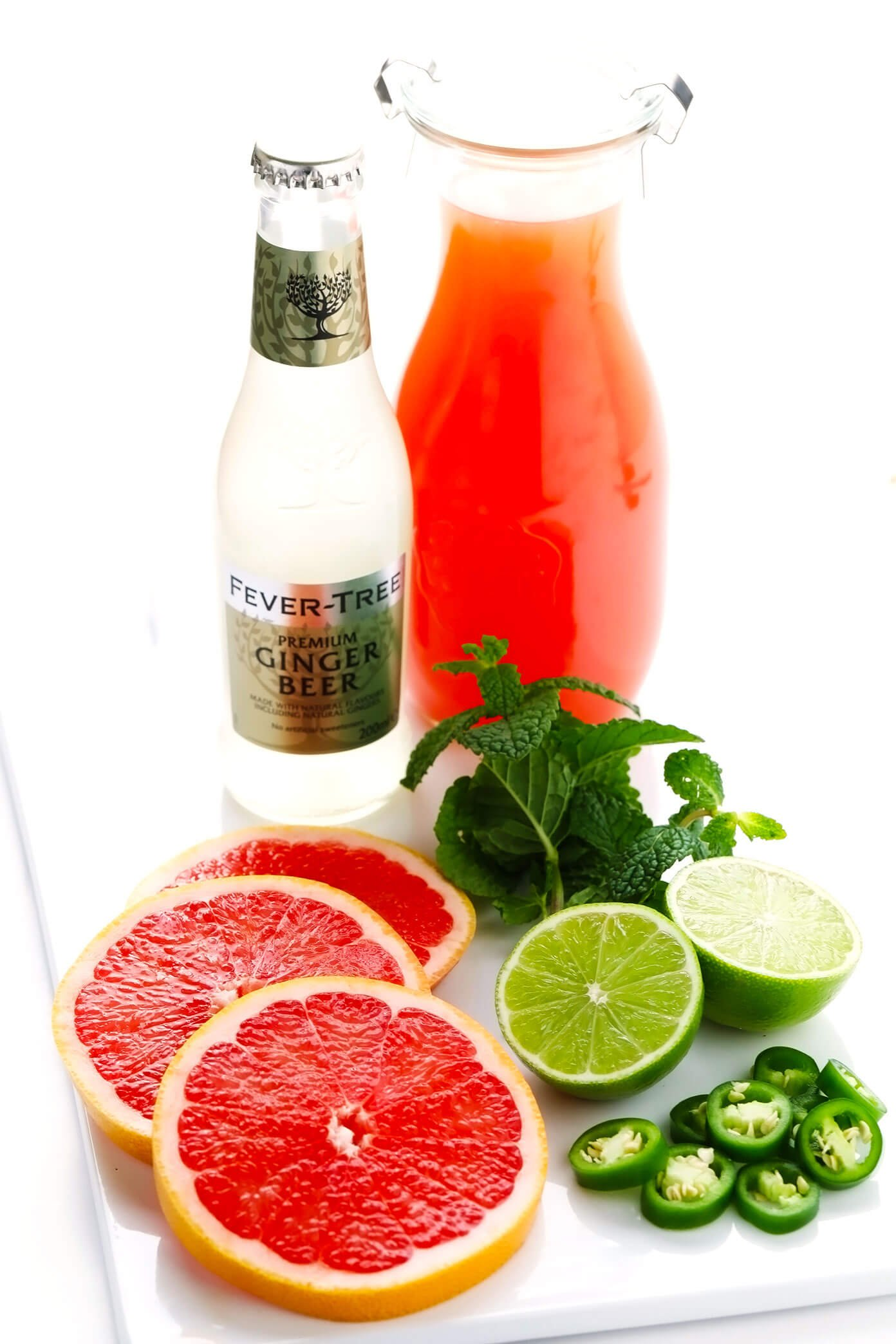 Mocktail ingredients (grapefruit juice, ginger beer, grapefruit, lime, mint, jalapeno)