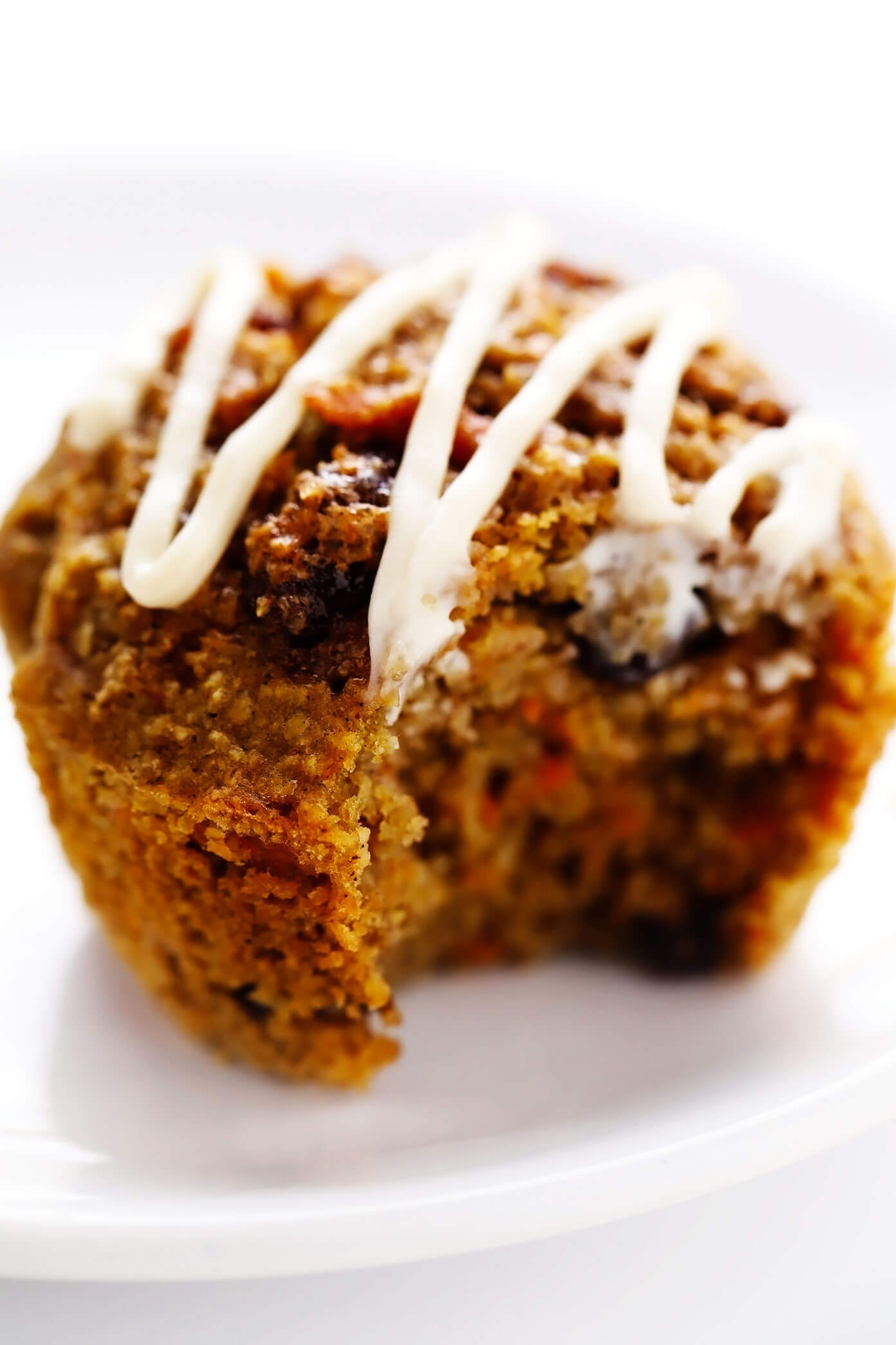Healthy Carrot Cake Muffin with Bite Taken Out