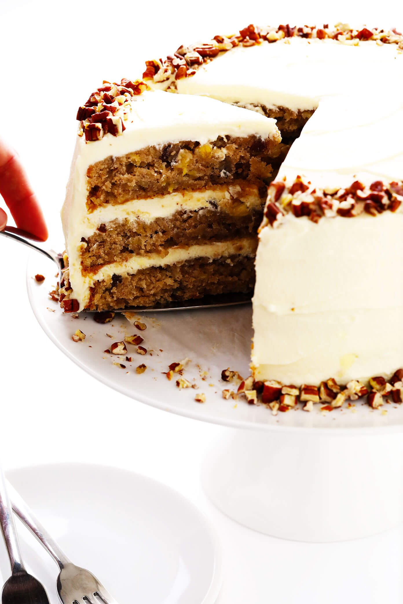 Cutting a slice of hummingbird cake