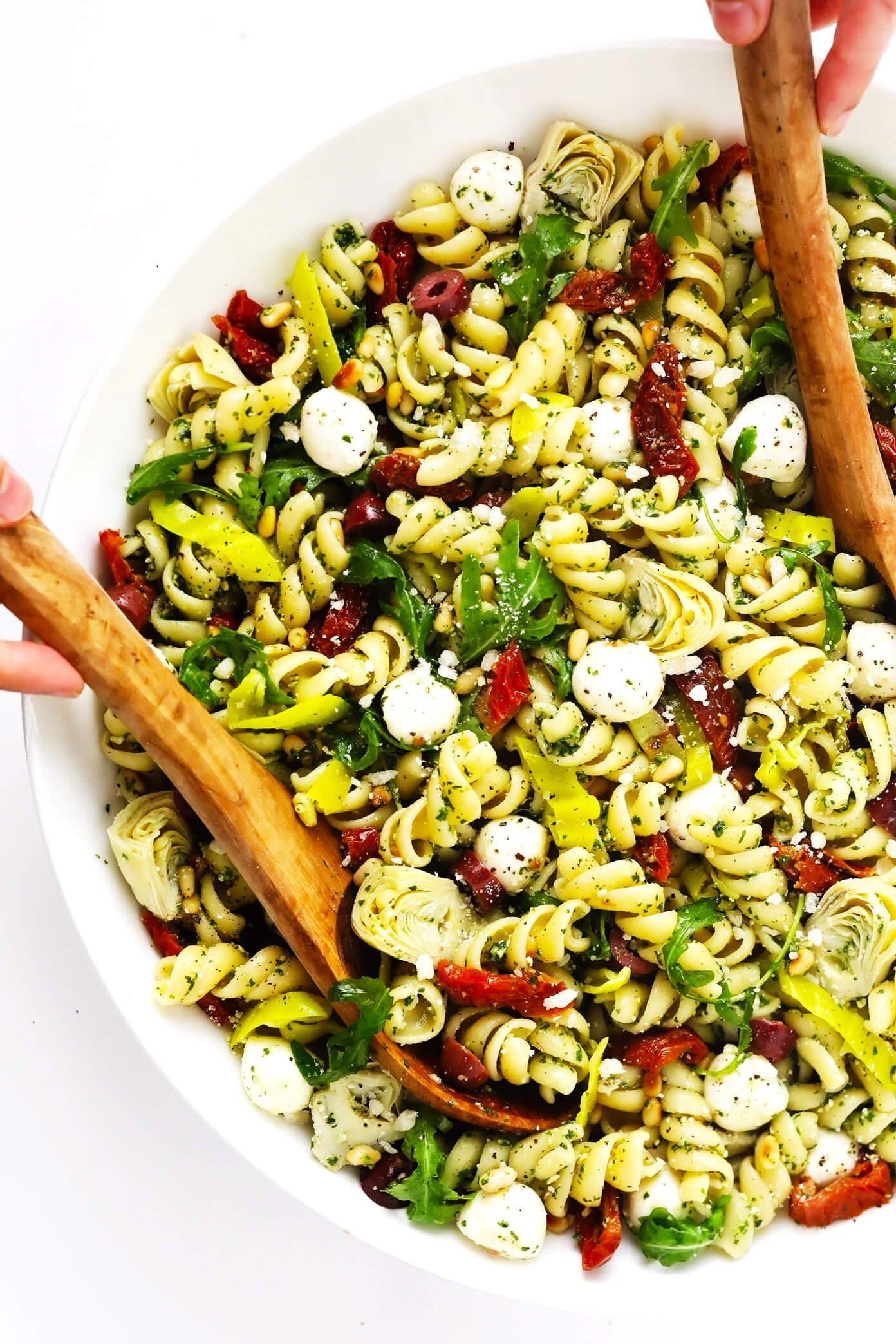 Italian Pesto Pasta Salad in Bowl with Tongs