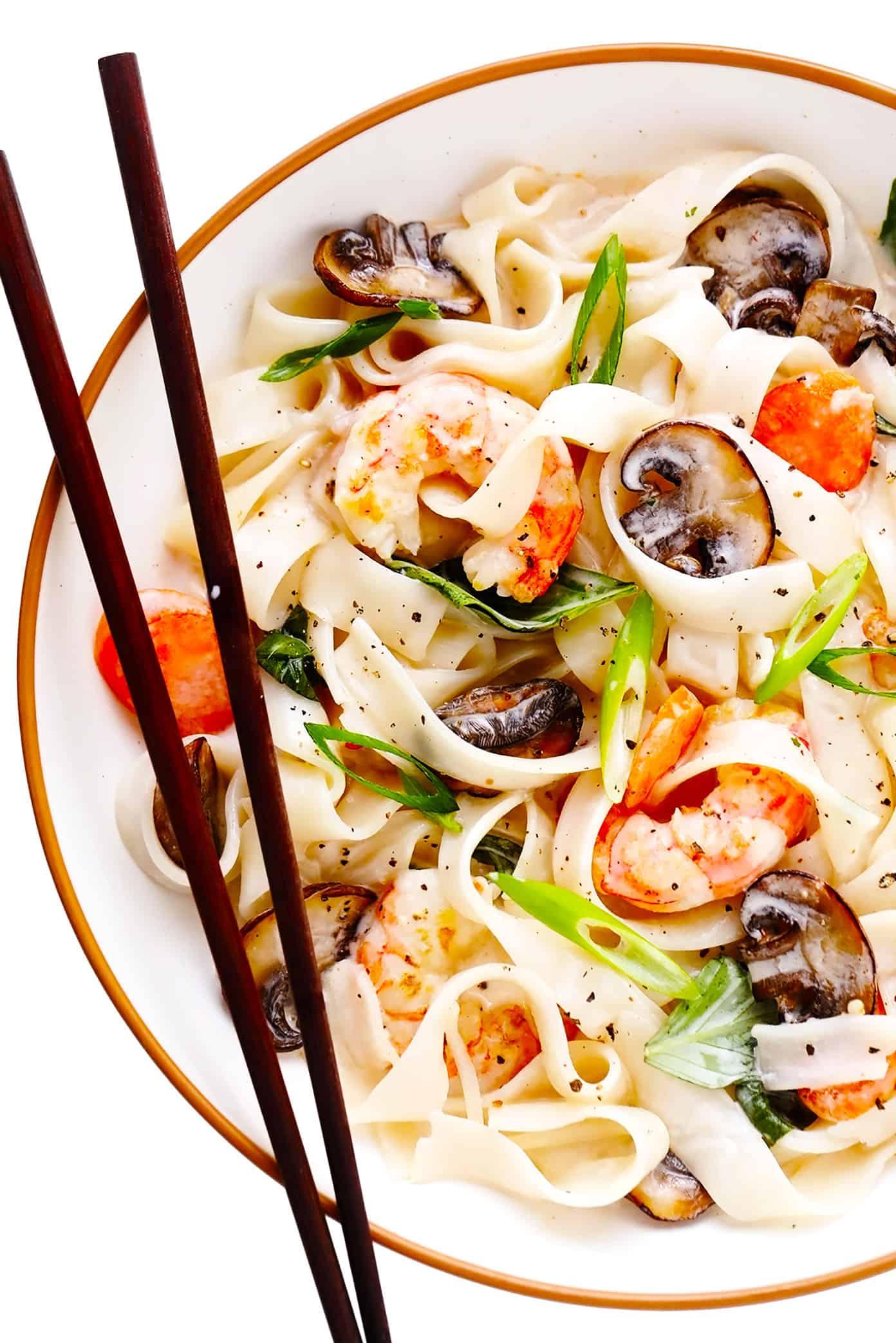 Bowl of lemongrass coconut rice noodles with shrimp and chopsticks