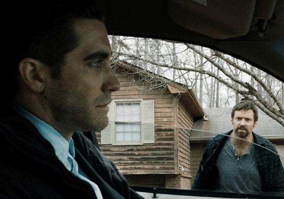 Jake Gyllenhaal and Hugh Jackman in Prisoners. © 2013 - Warner Bros. Pictures