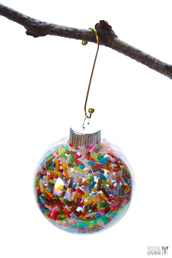 These DIY Sprinkles Ornaments are easy to make and customize with your favorite colors of sprinkles. The perfect homemade decor for your Christmas tree this year! | Gimme Some Oven